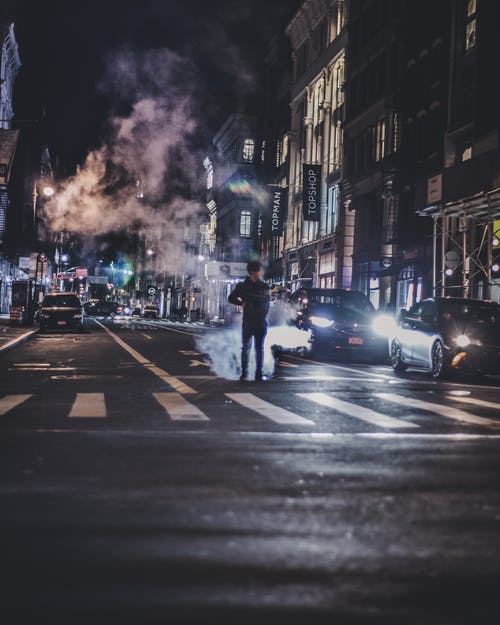 Photo of Man in the Middle of the Road