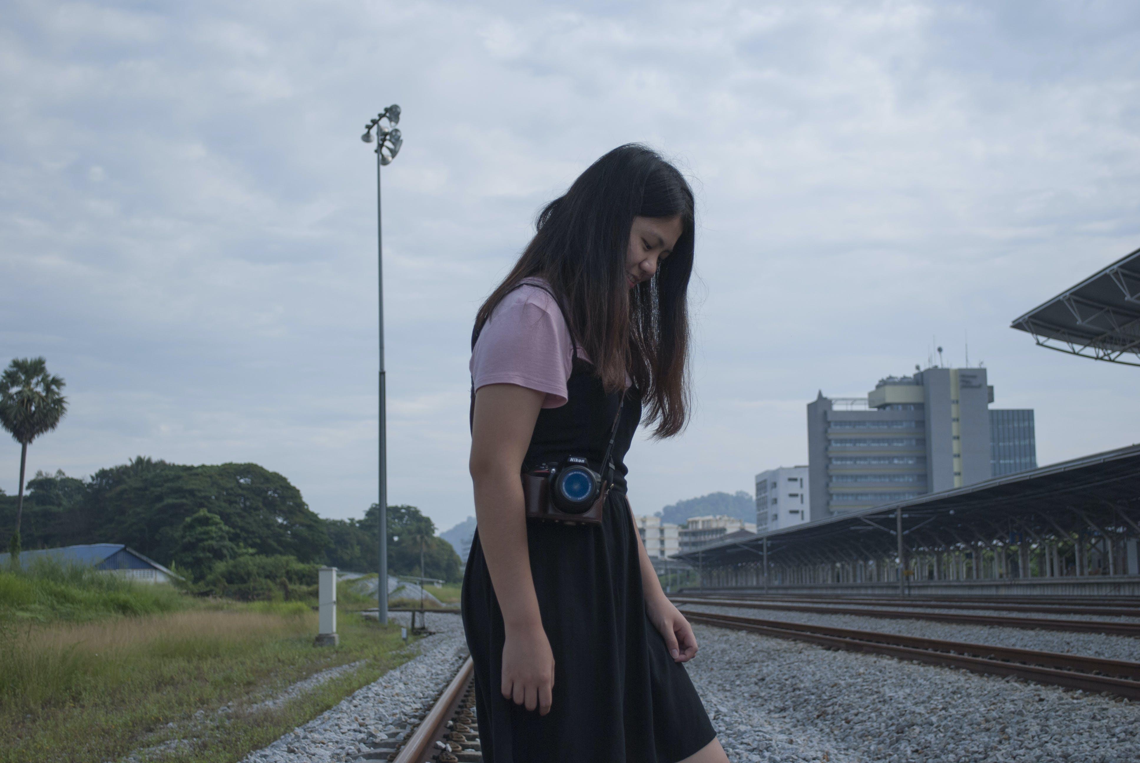 Free stock photo of alone, long hair, railway station