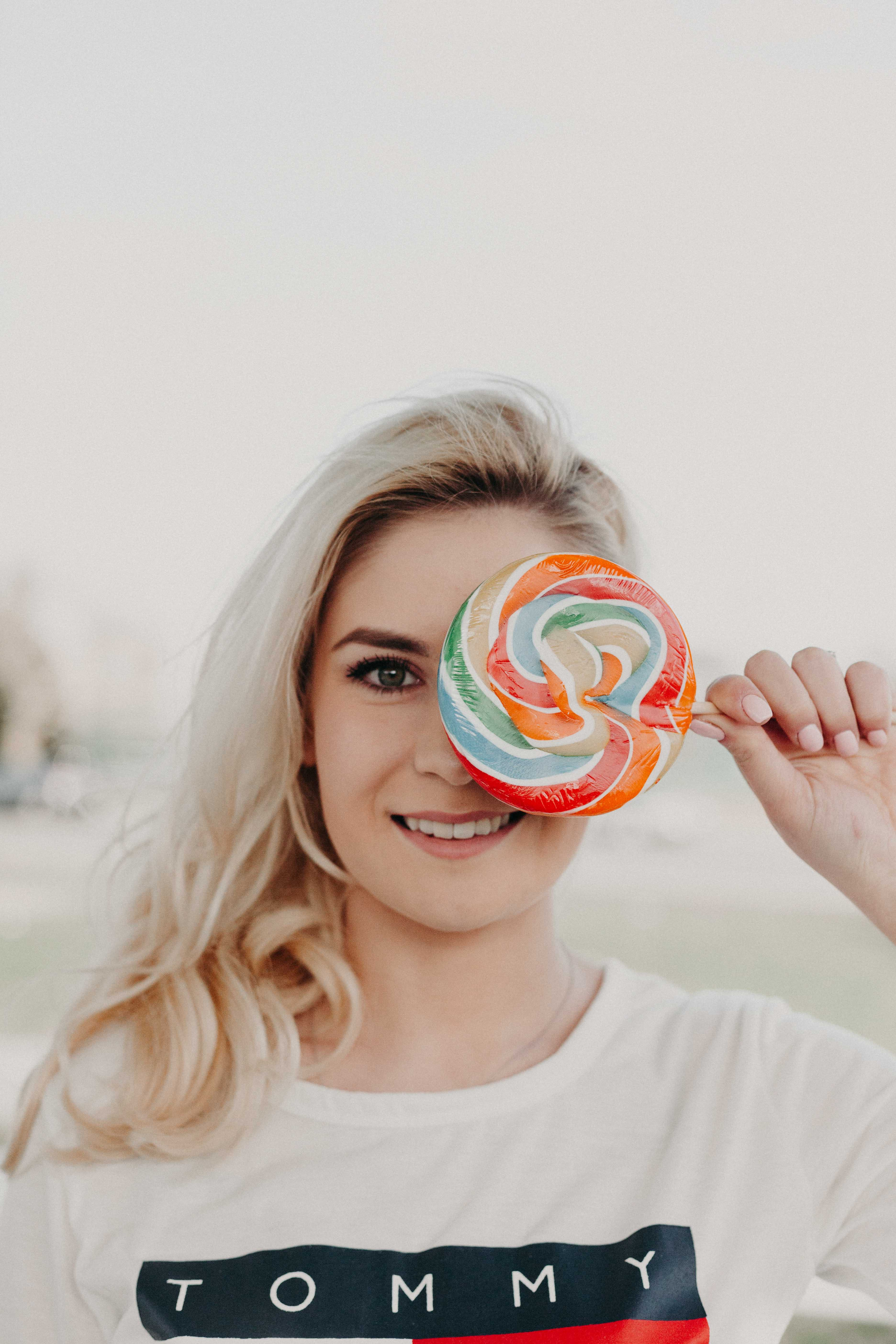 Close-Up Photography of a Woman Holding Lollipop
