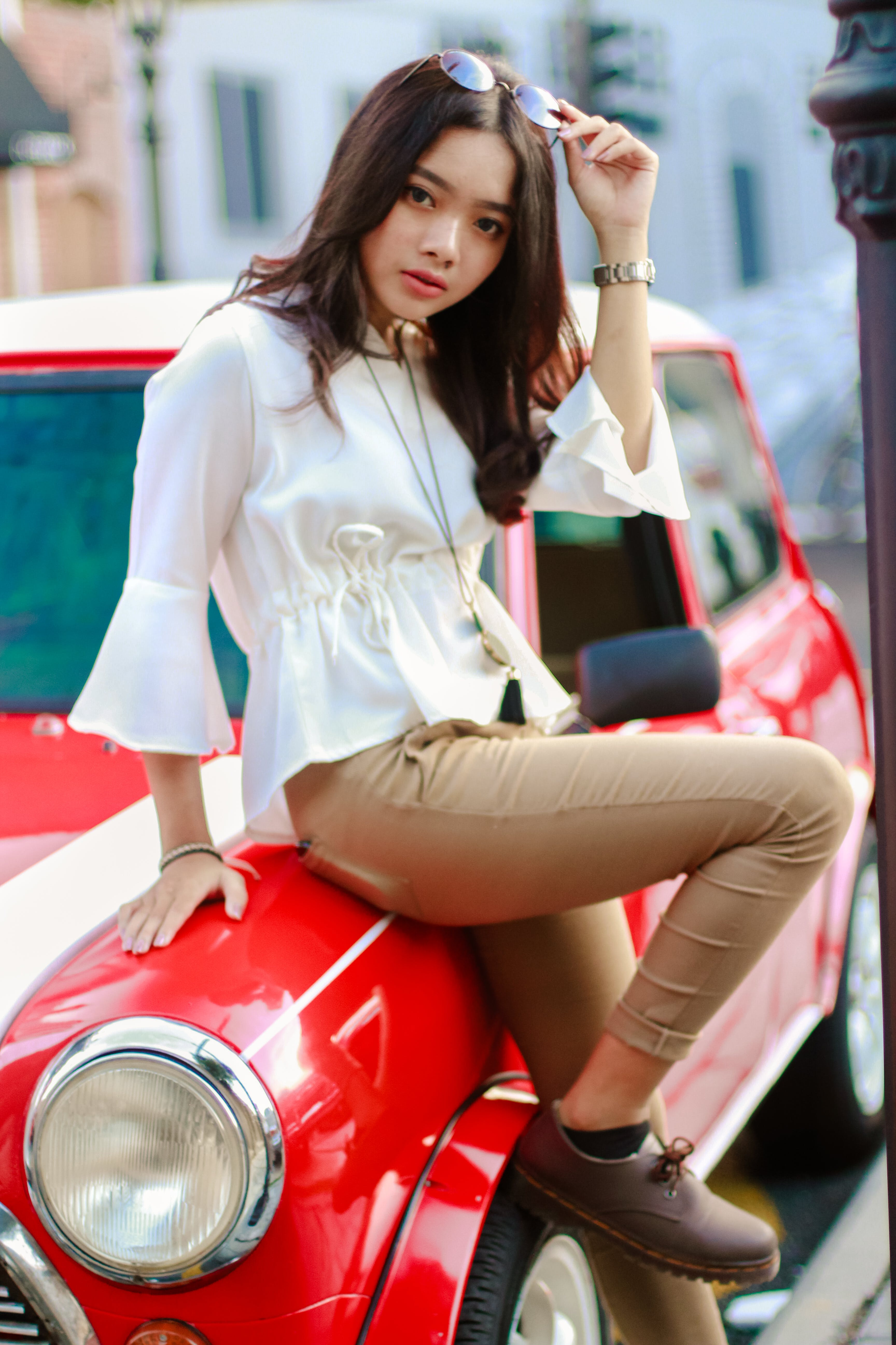 Photography of a Woman Leaning on the Car