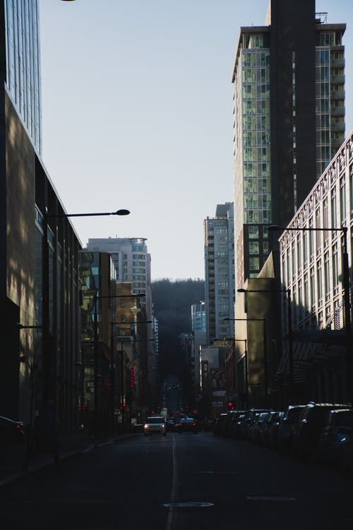 Photography of Roadway in Between Buildings