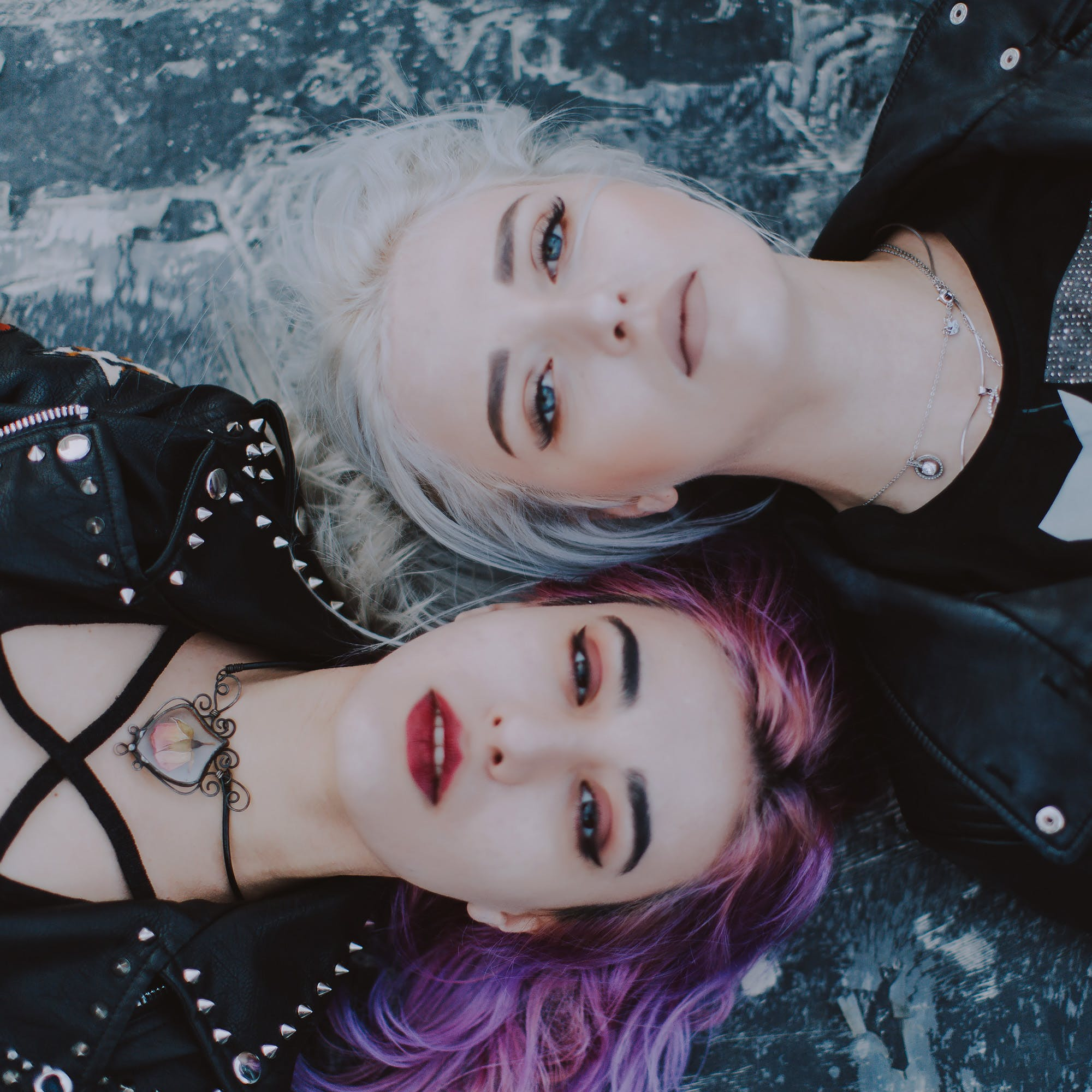 Focus Photo of Two Woman in Black Top