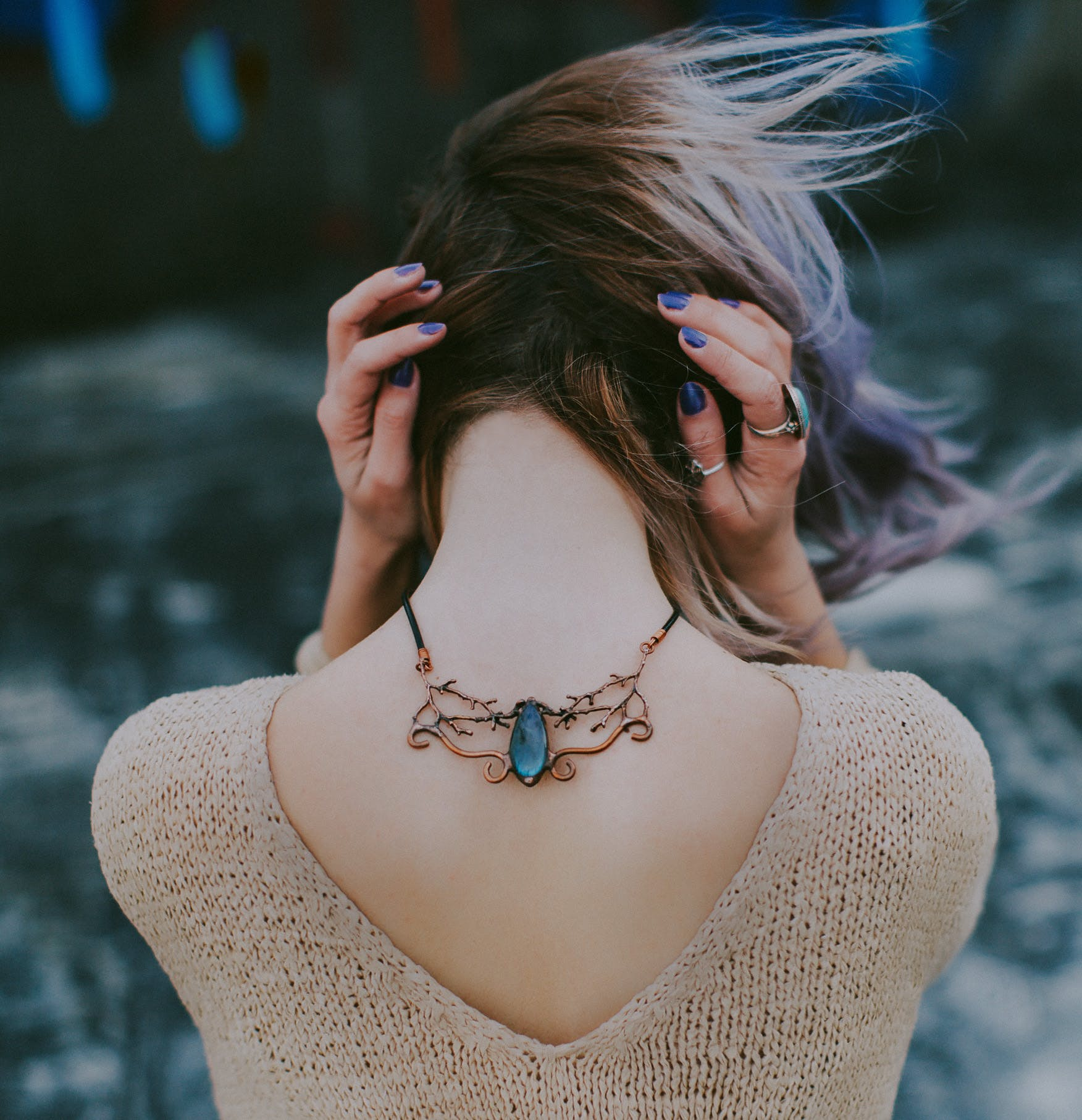 Woman Wears Gold-colored Blue Gemstone Pendant Necklace