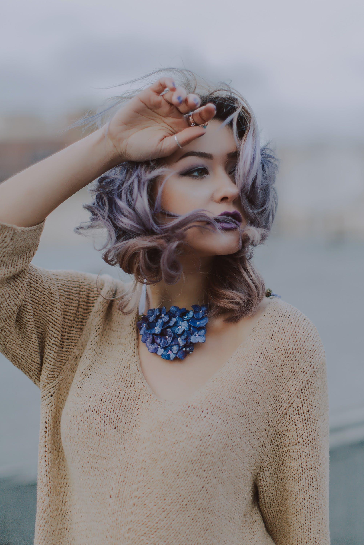 Woman Wearing Brown V-neck Knit Shirt