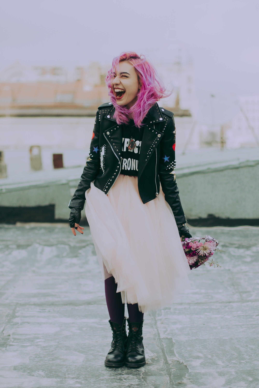 Woman Wearing Black Jacket Holding Pink Flowers