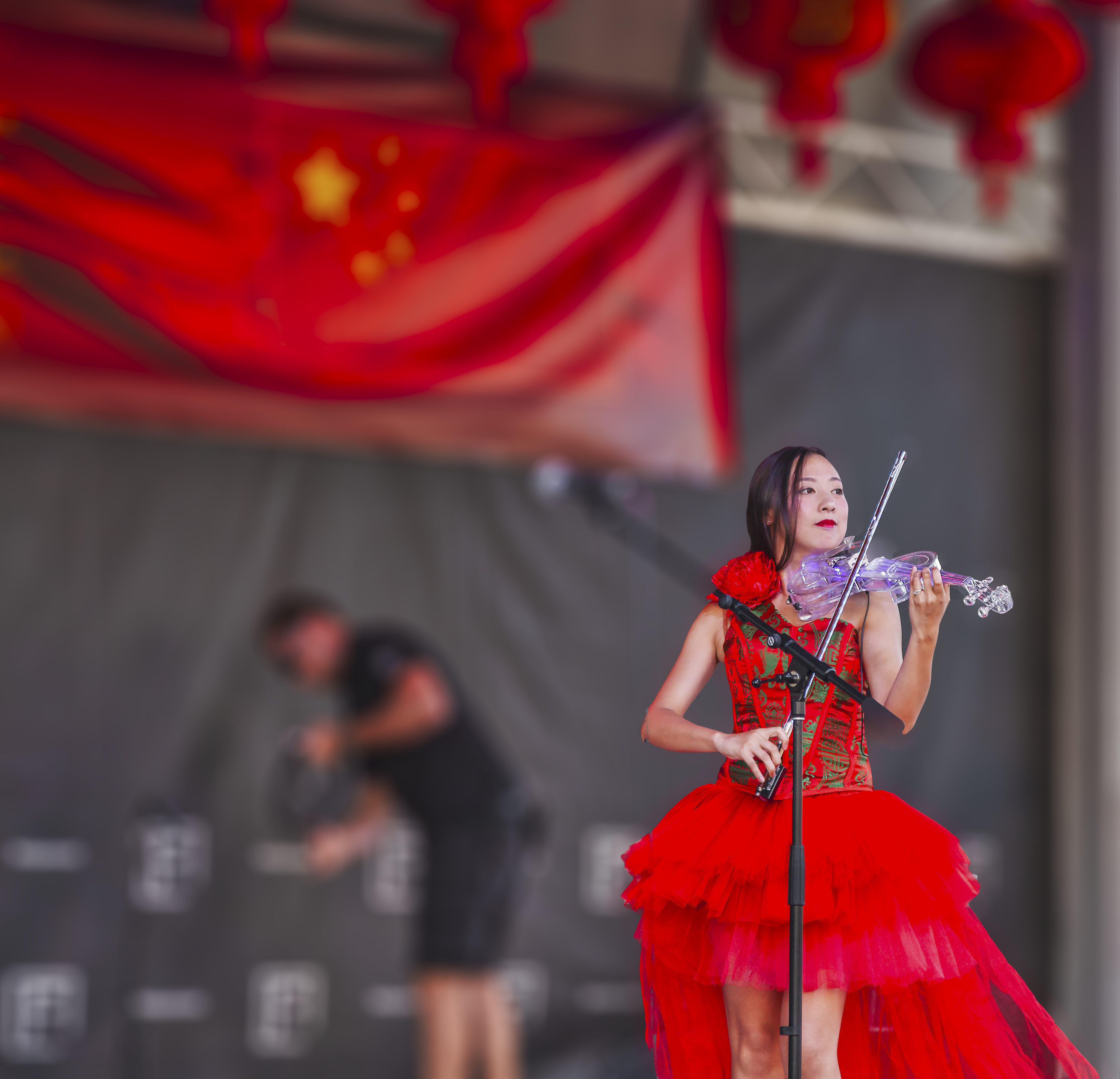 Woman Playing Electric Flying on Stage