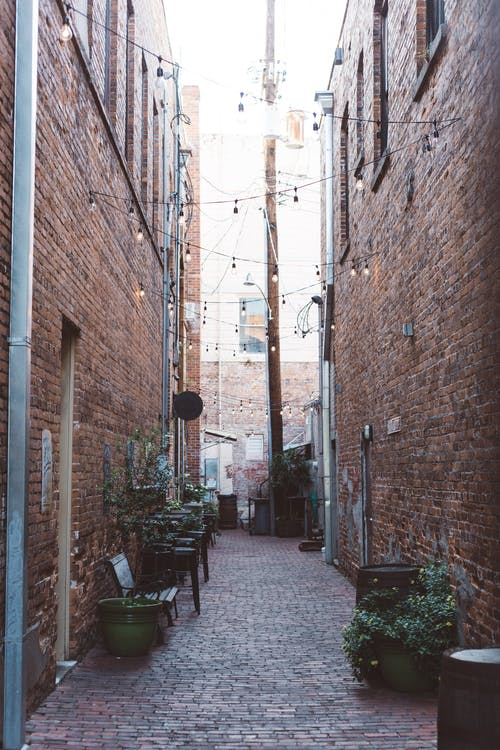 Street Alley Between Brown Bricked Houses