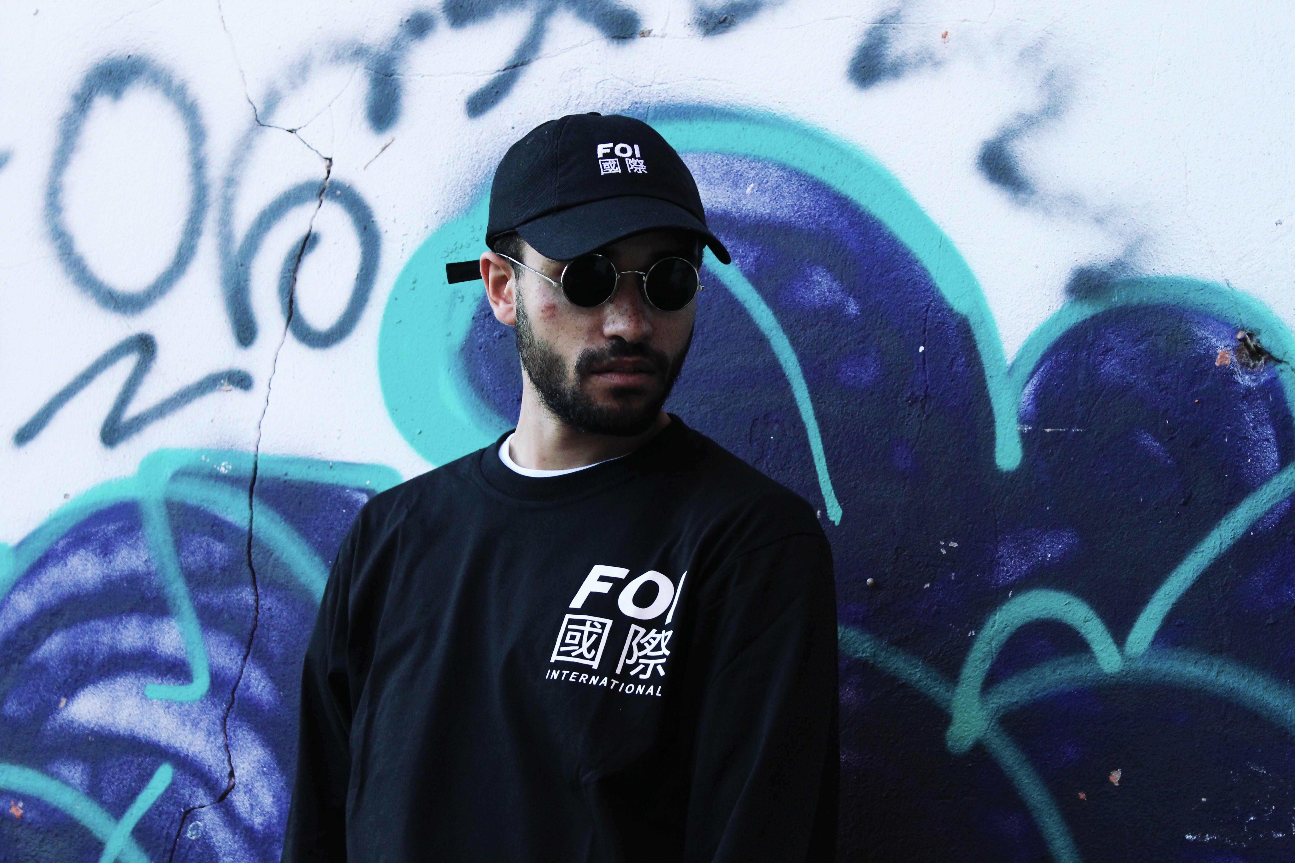 Photo of a Man Wearing Black Sunglasses
