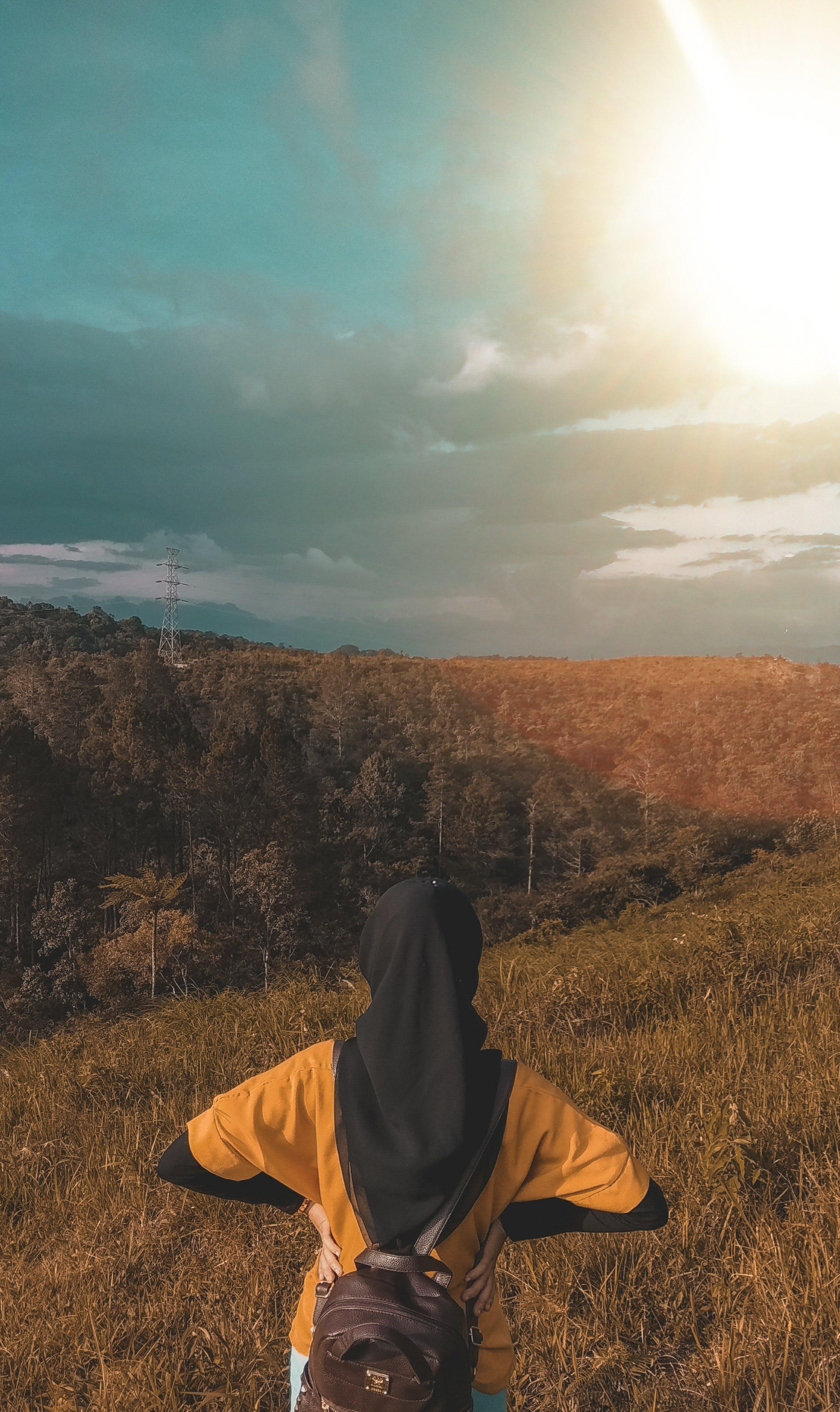 Woman Wearing Black Headdress on Top of Mountain