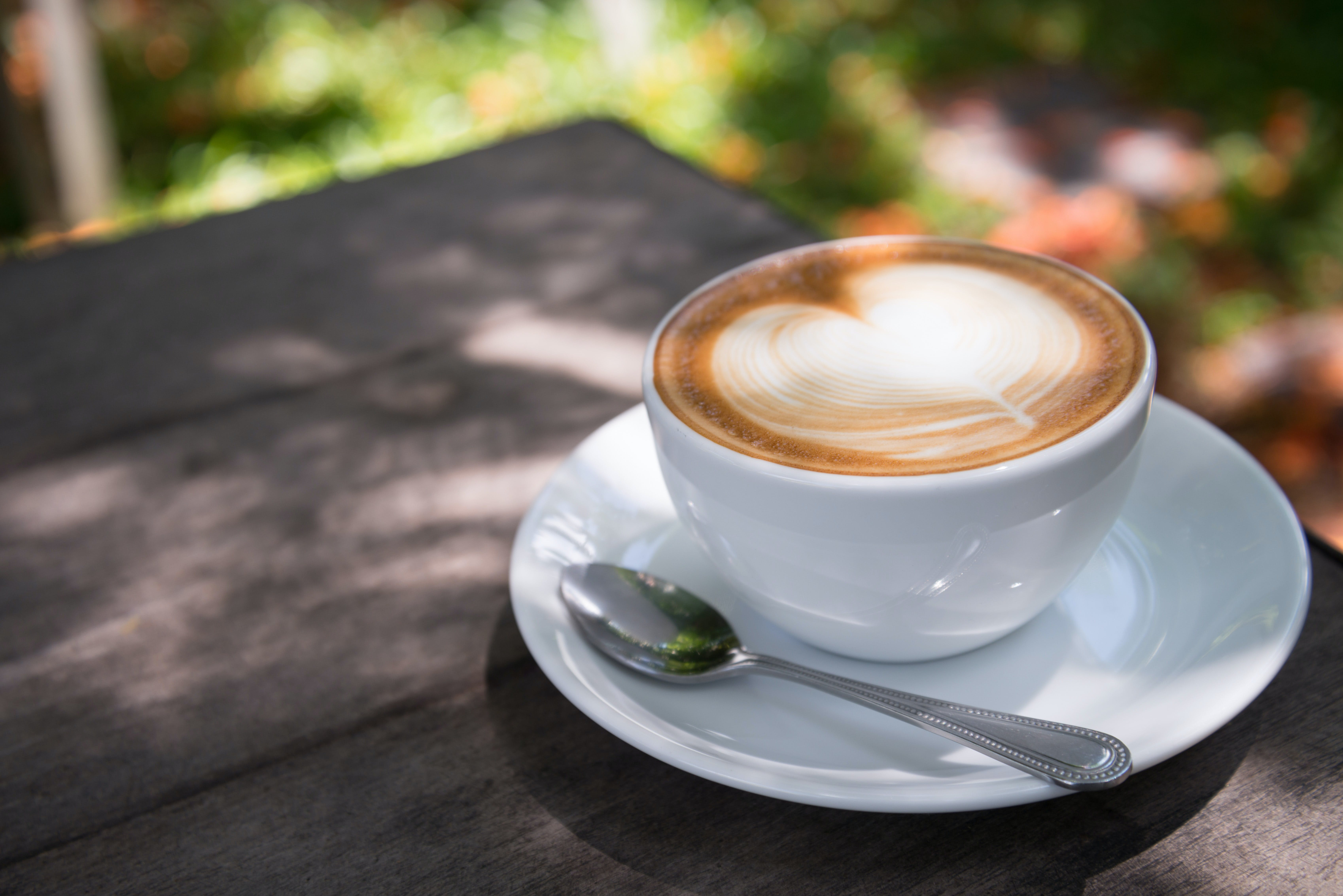 White Ceramic Cup Filled With Latte