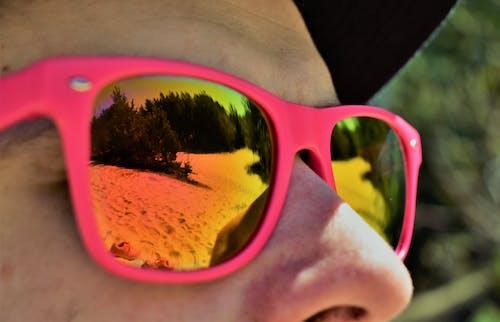 Kostenloses Stock Foto zu augen, blick, junge, reflektierung