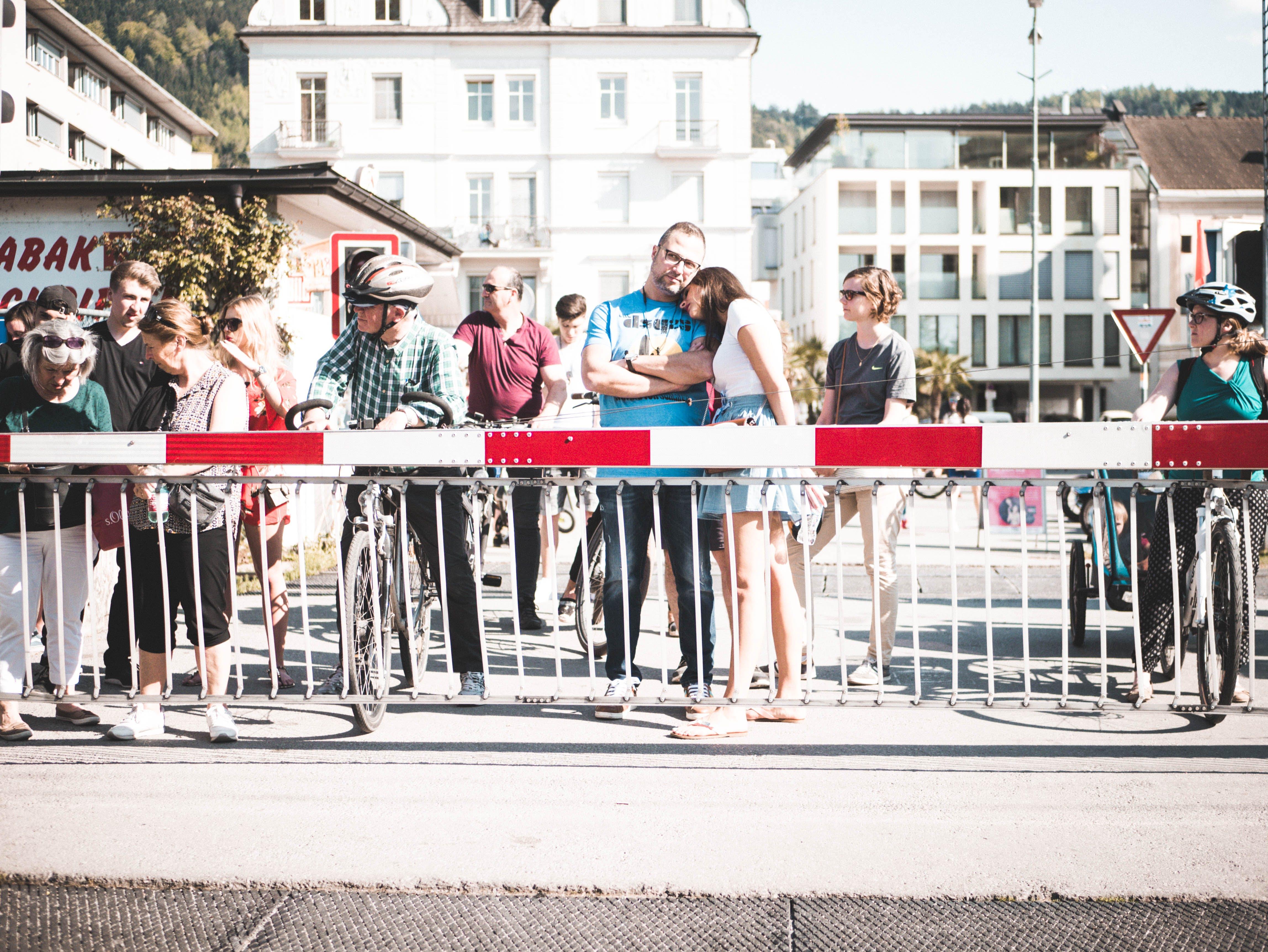 People Standing Near Handrail