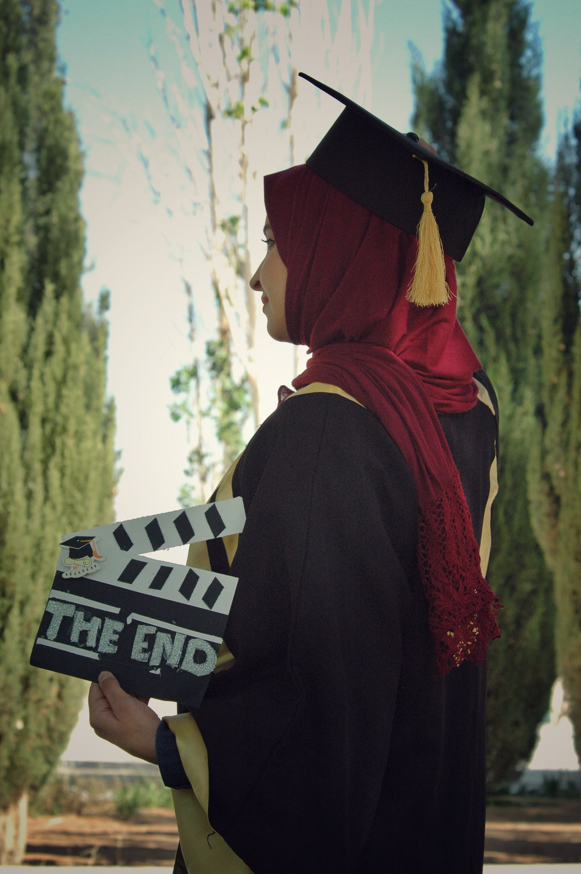 Woman Wearing Academic Dress While Holding Clipperboard