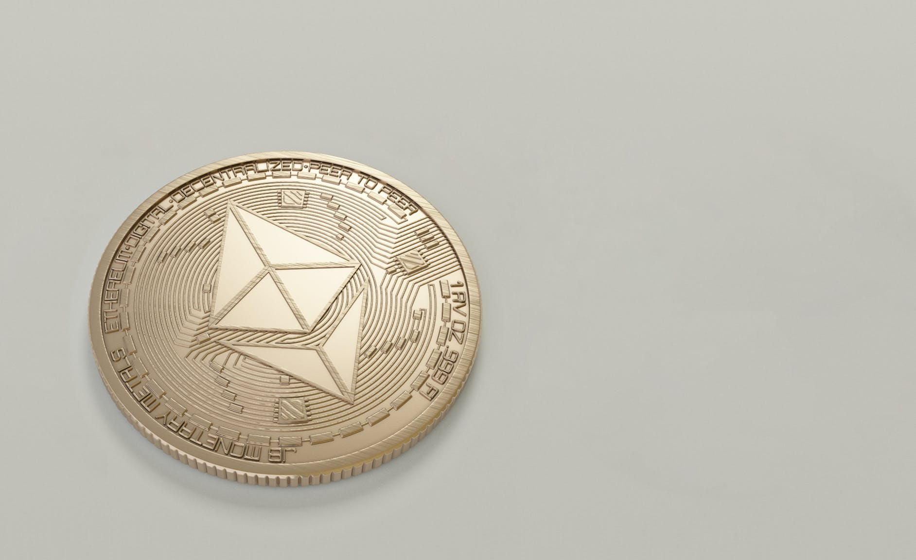 Round Gold-colored Ethereum Coin