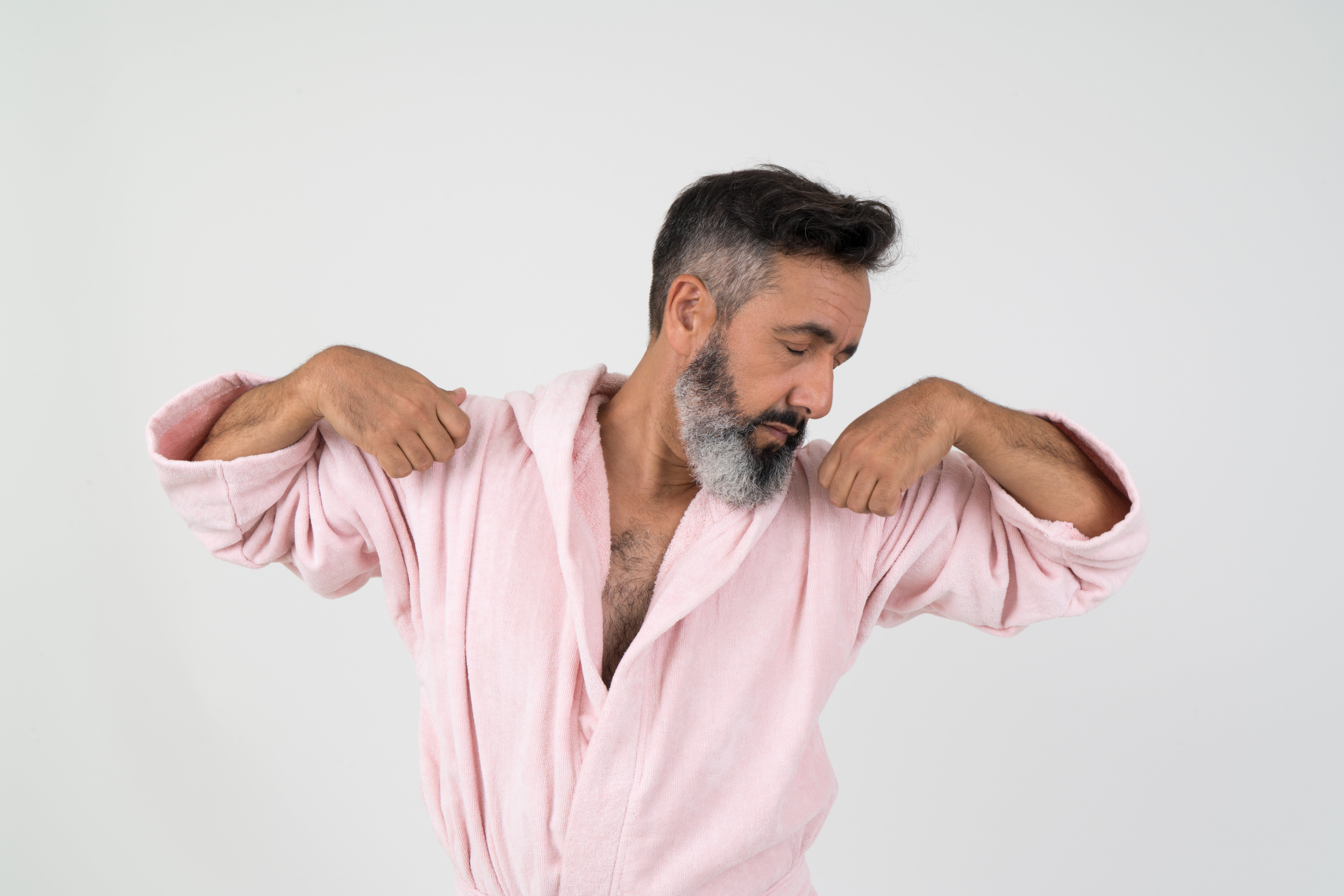 Man Wearing Pink Bathrobe With Both Hands on Shoulder