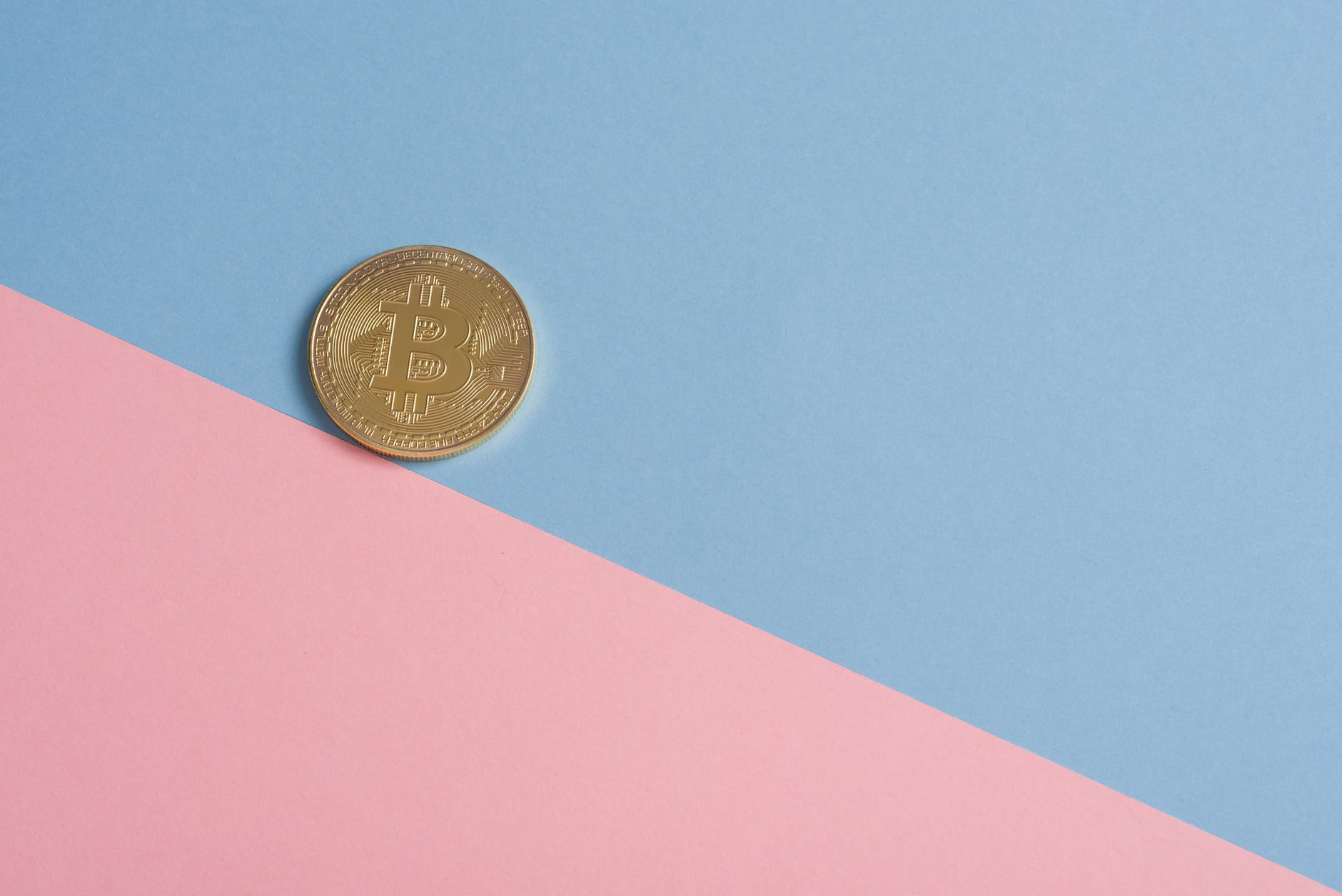 Bitcoin on pink and blue background