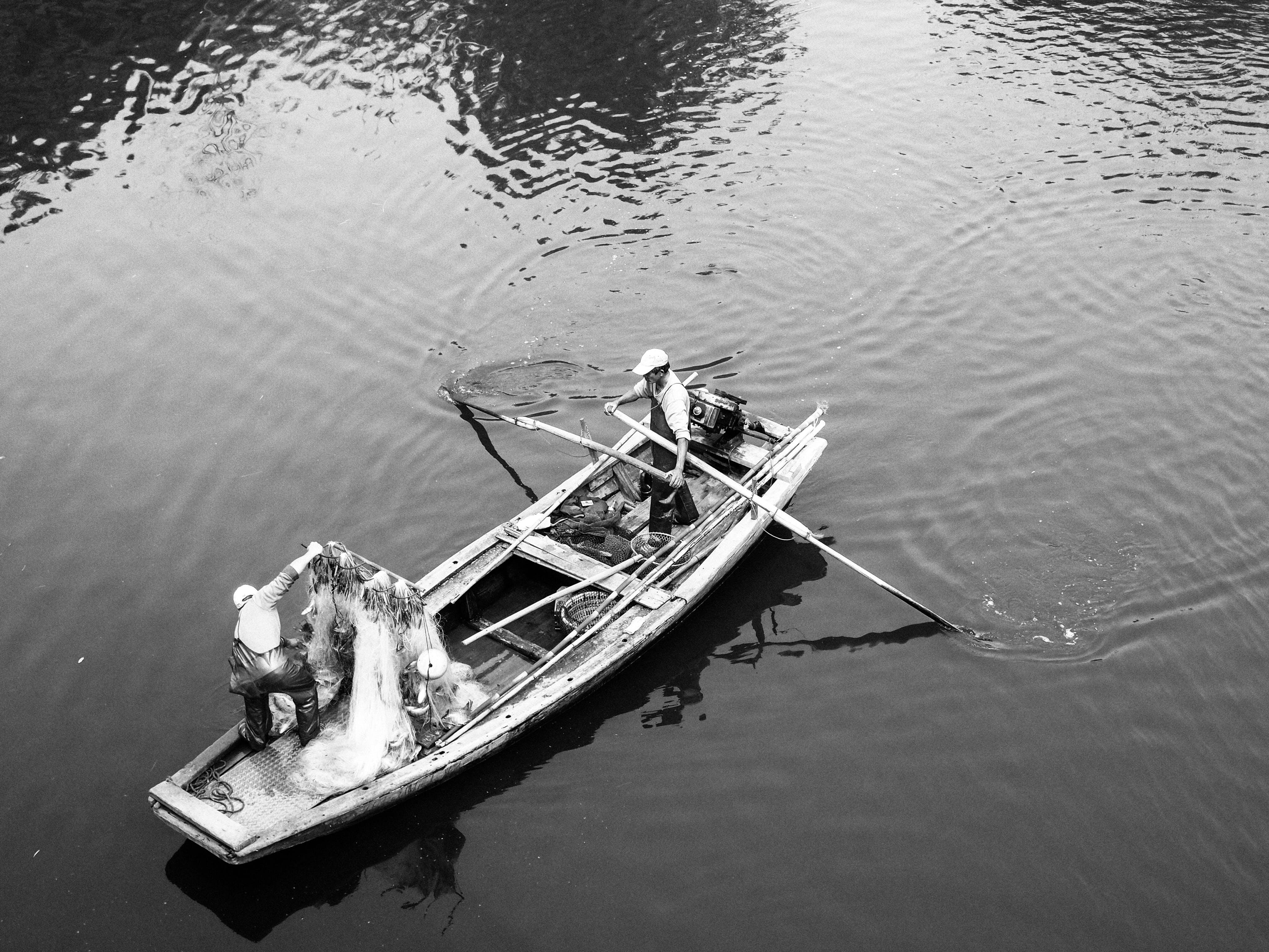 Man in White Boat