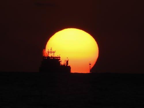 Free stock photo of cargo ship, evening sun, sunset