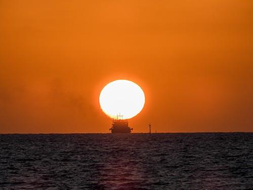 Free stock photo of cargo ship, sunset