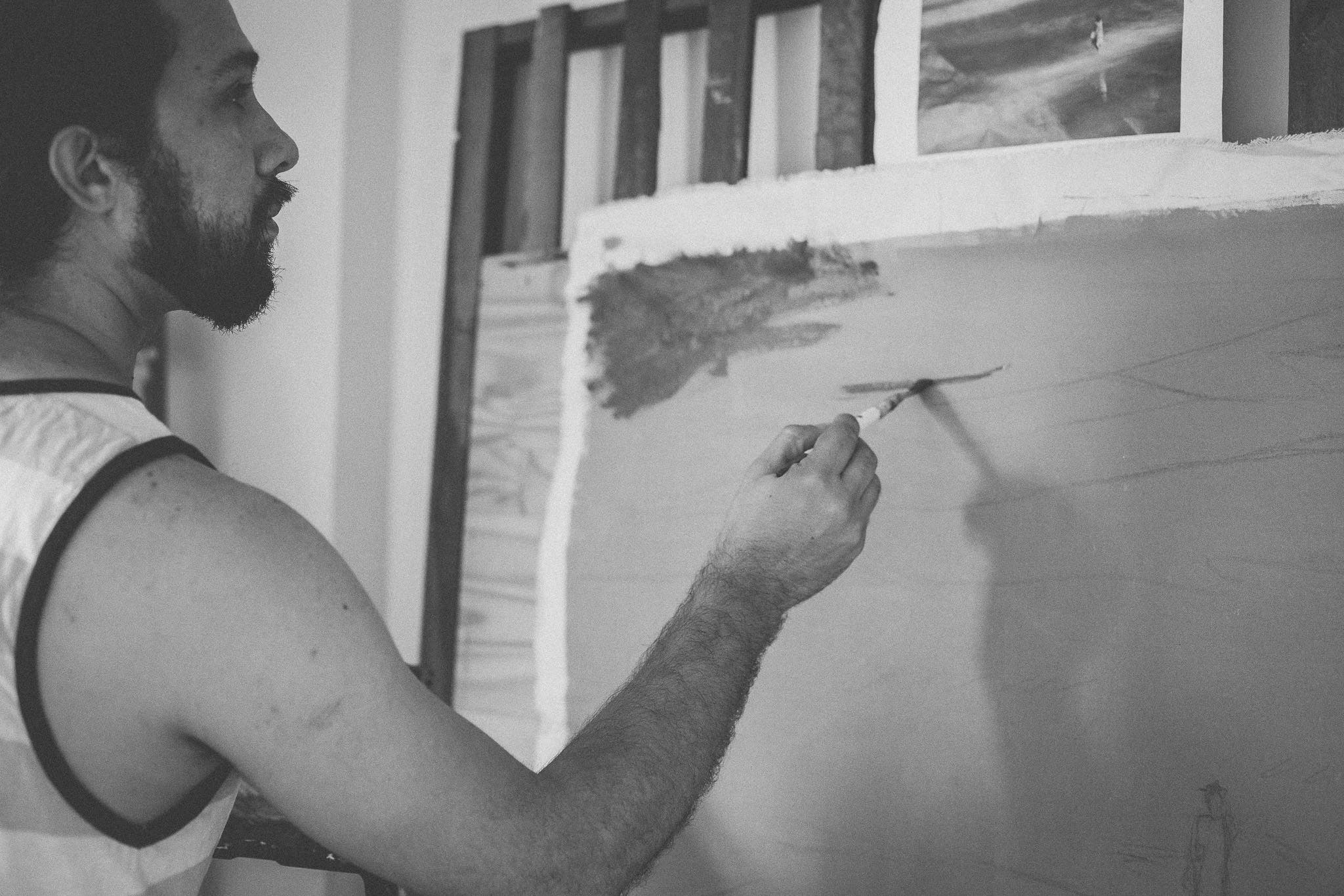Grayscale Photo of Man Painting