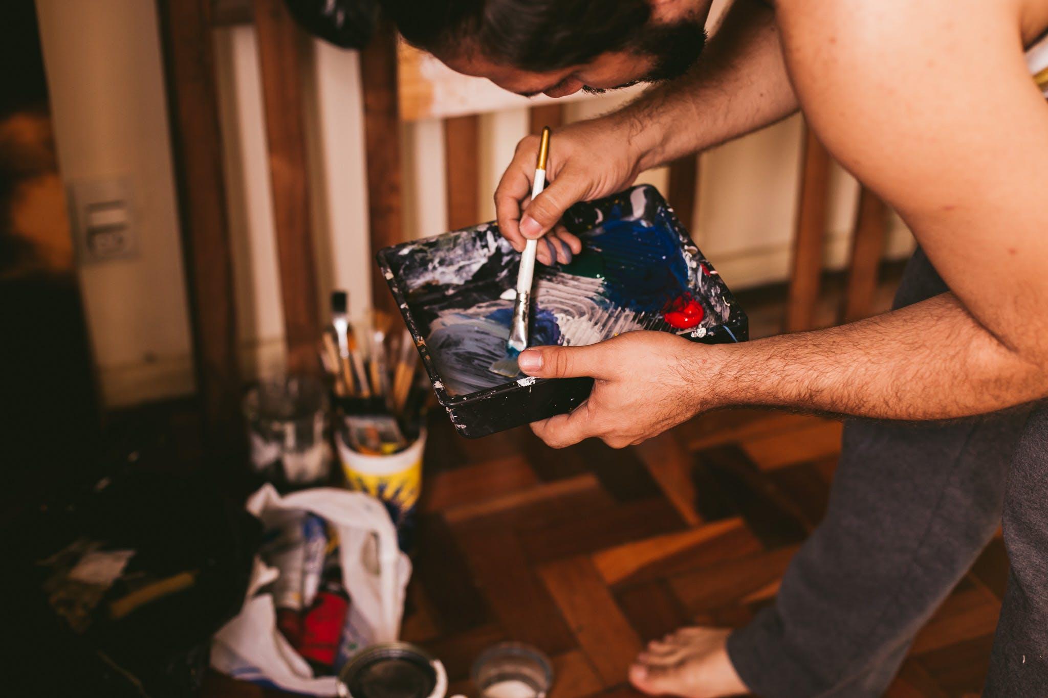 Man Holding Paint Brush