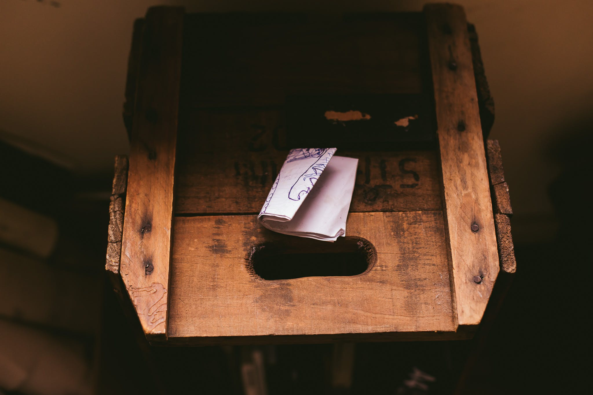 White Printing Paper on Brown Wooden Crate