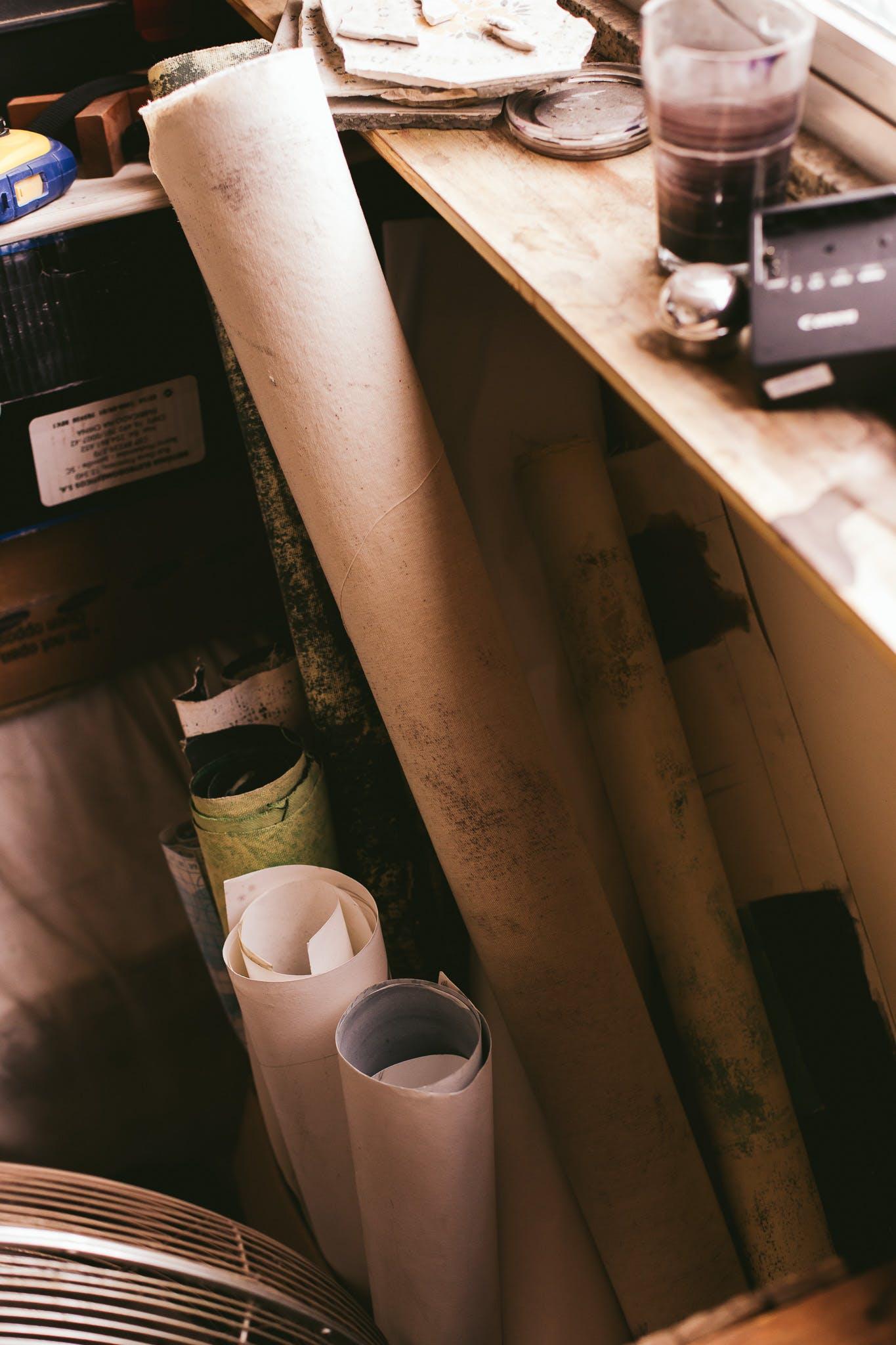 Assorted-color Paper Rolls Beside Wooden Shelf