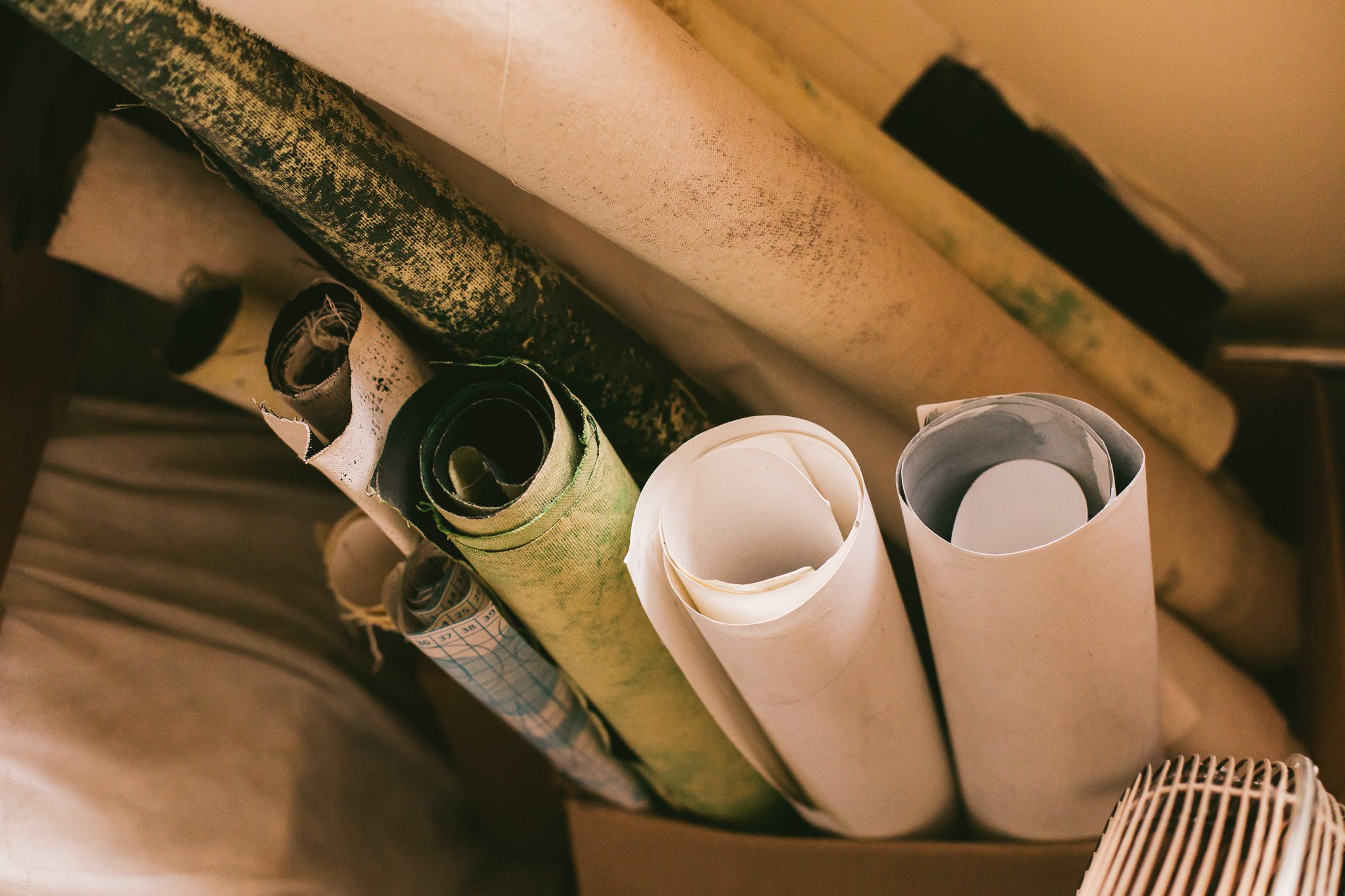 Assorted-color Rolled Paper Beside White Textile