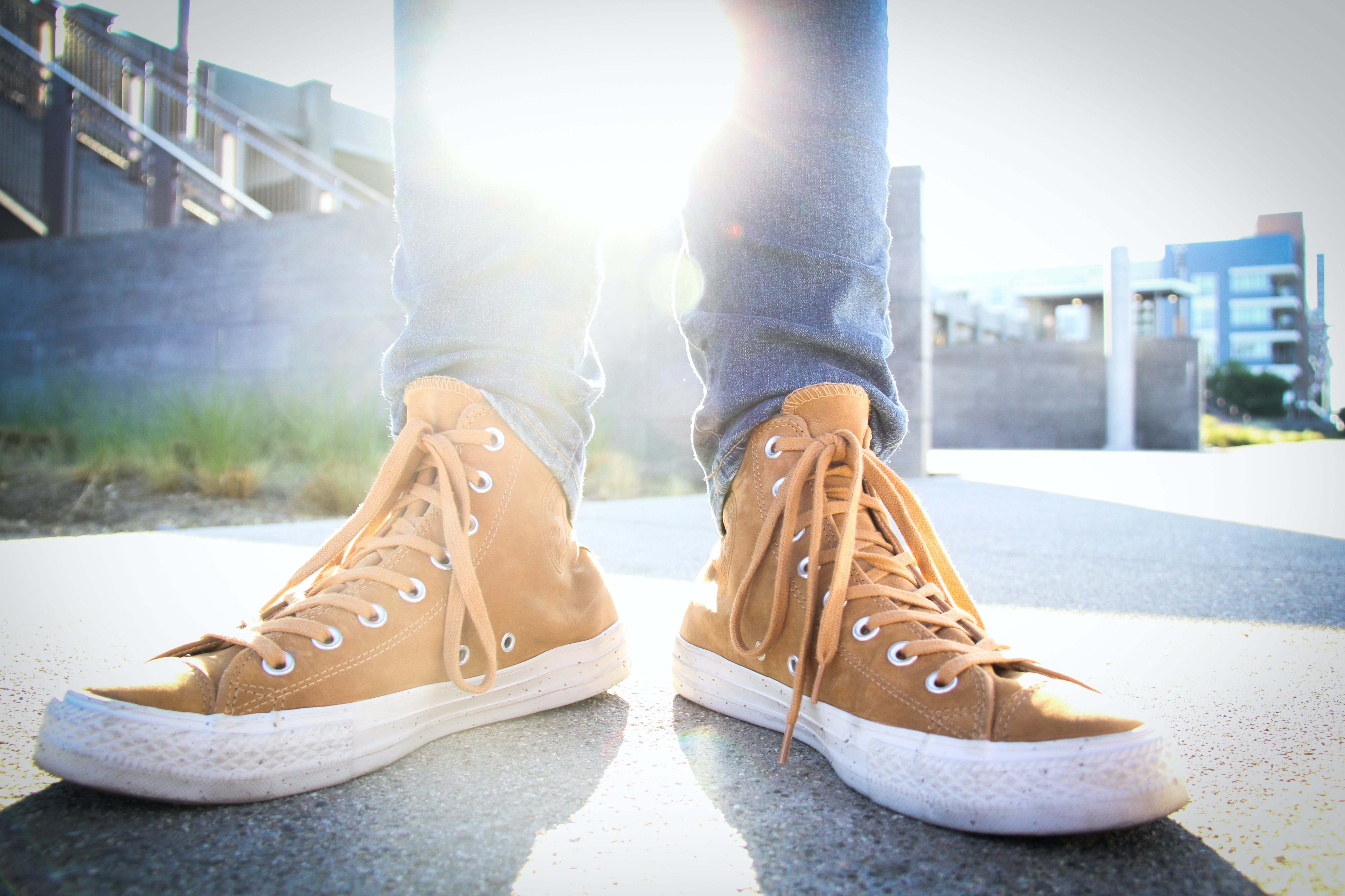Person Wearing Brown-and-white High-top Sneakers