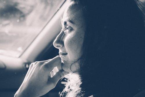 Grayscale Photo of Woman Inside Vehicle