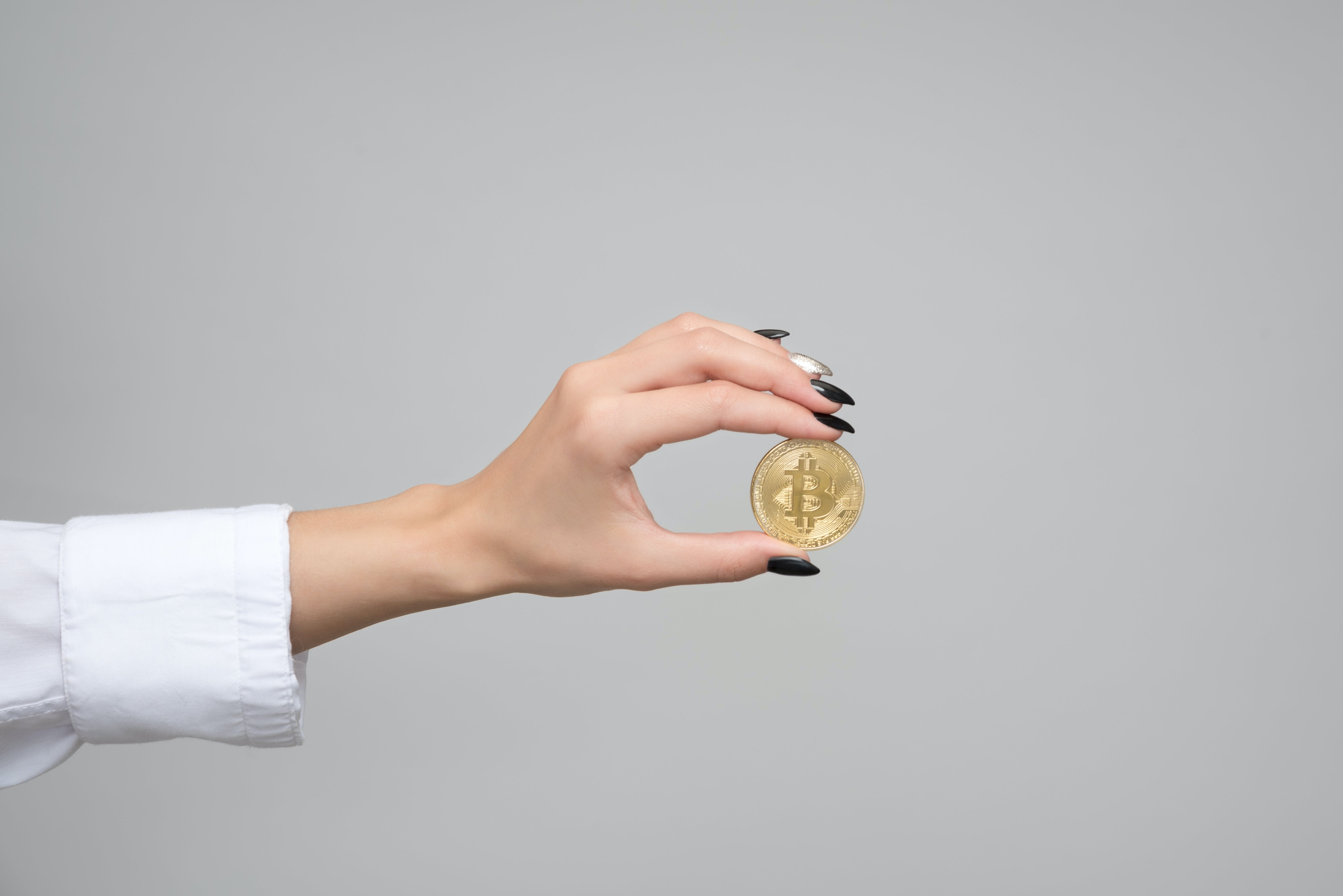 Woman Holding a Bitcoin