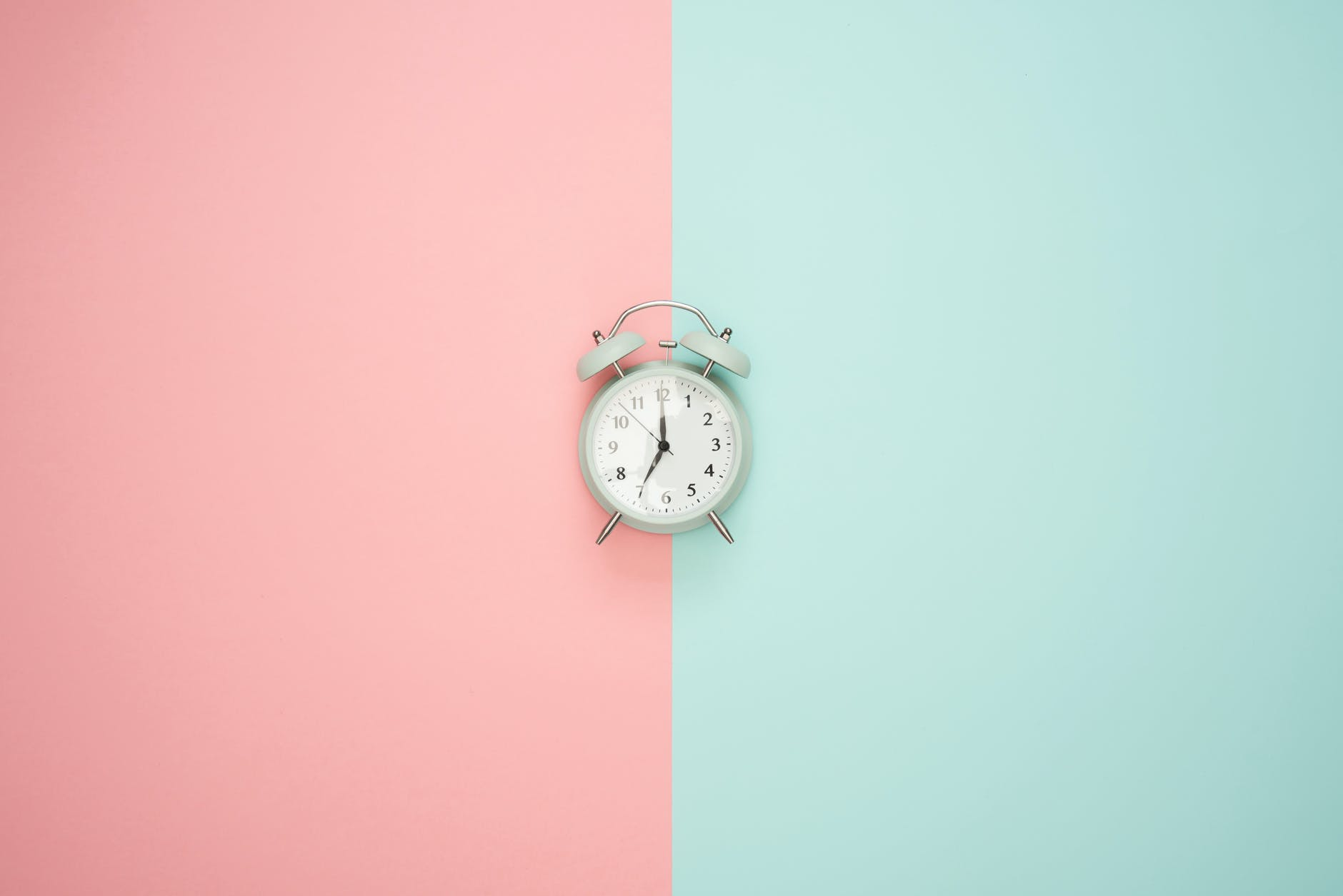 Clock at the pink blue wall