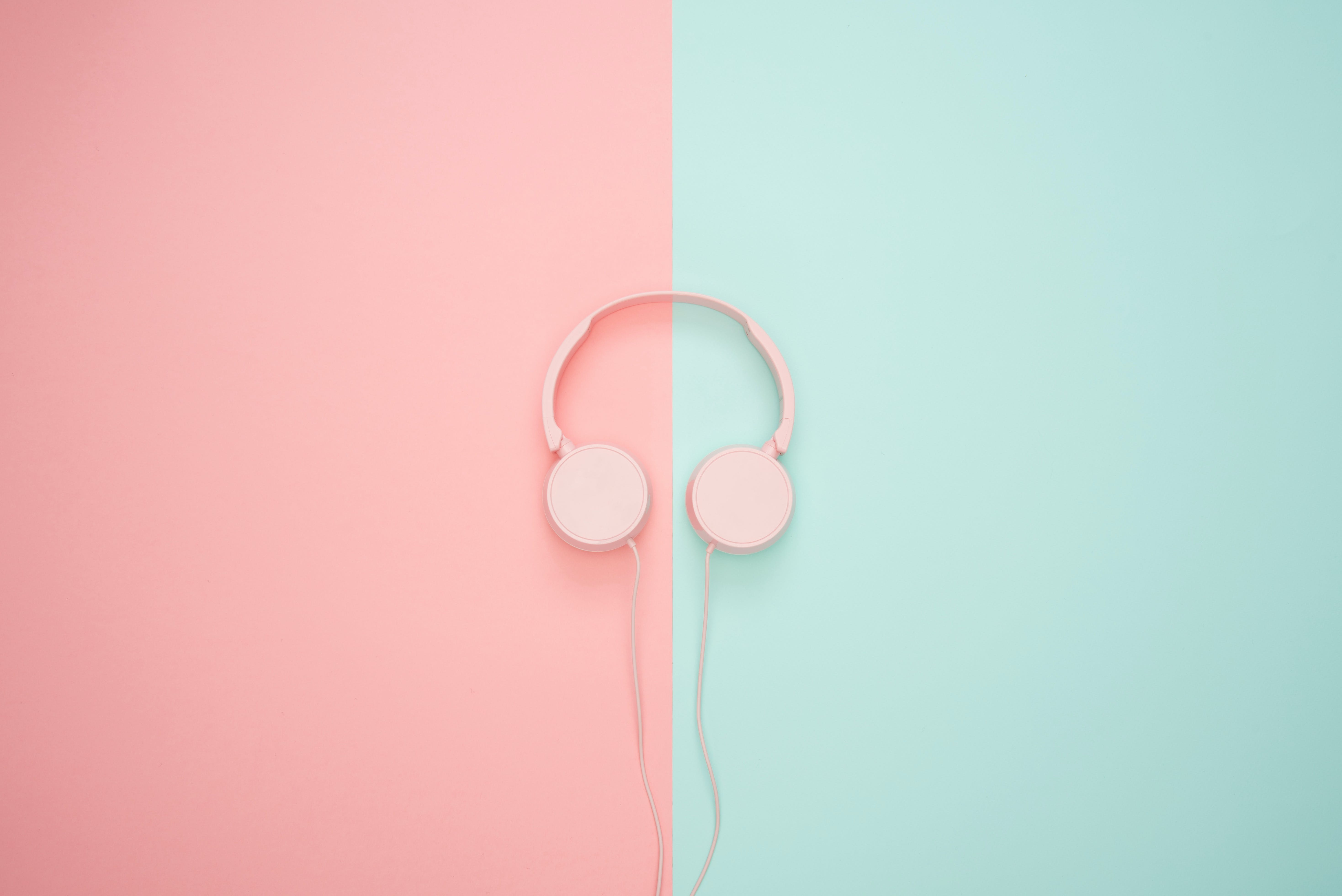 Pink Corded Headphones on pink and teal Wall