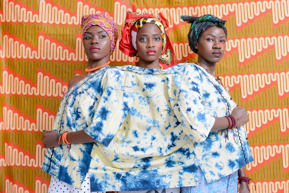 Three African Women in White-and-blue Top, Traditional cloths