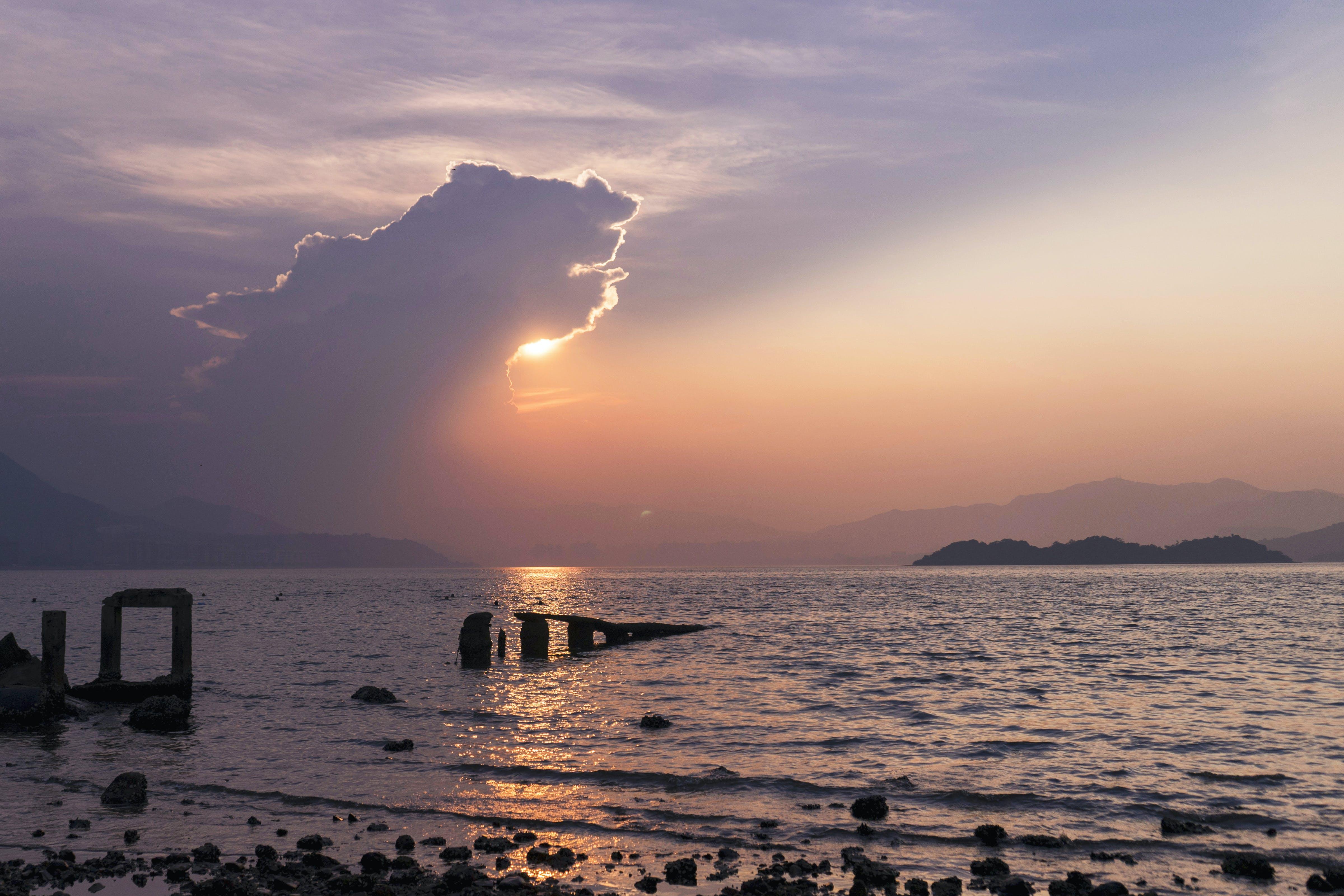 Seashore Under Cloudy Sky in Golden Hour Photography