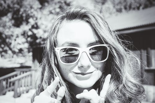 Grayscale Photography of Woman Wearing Sunglasses