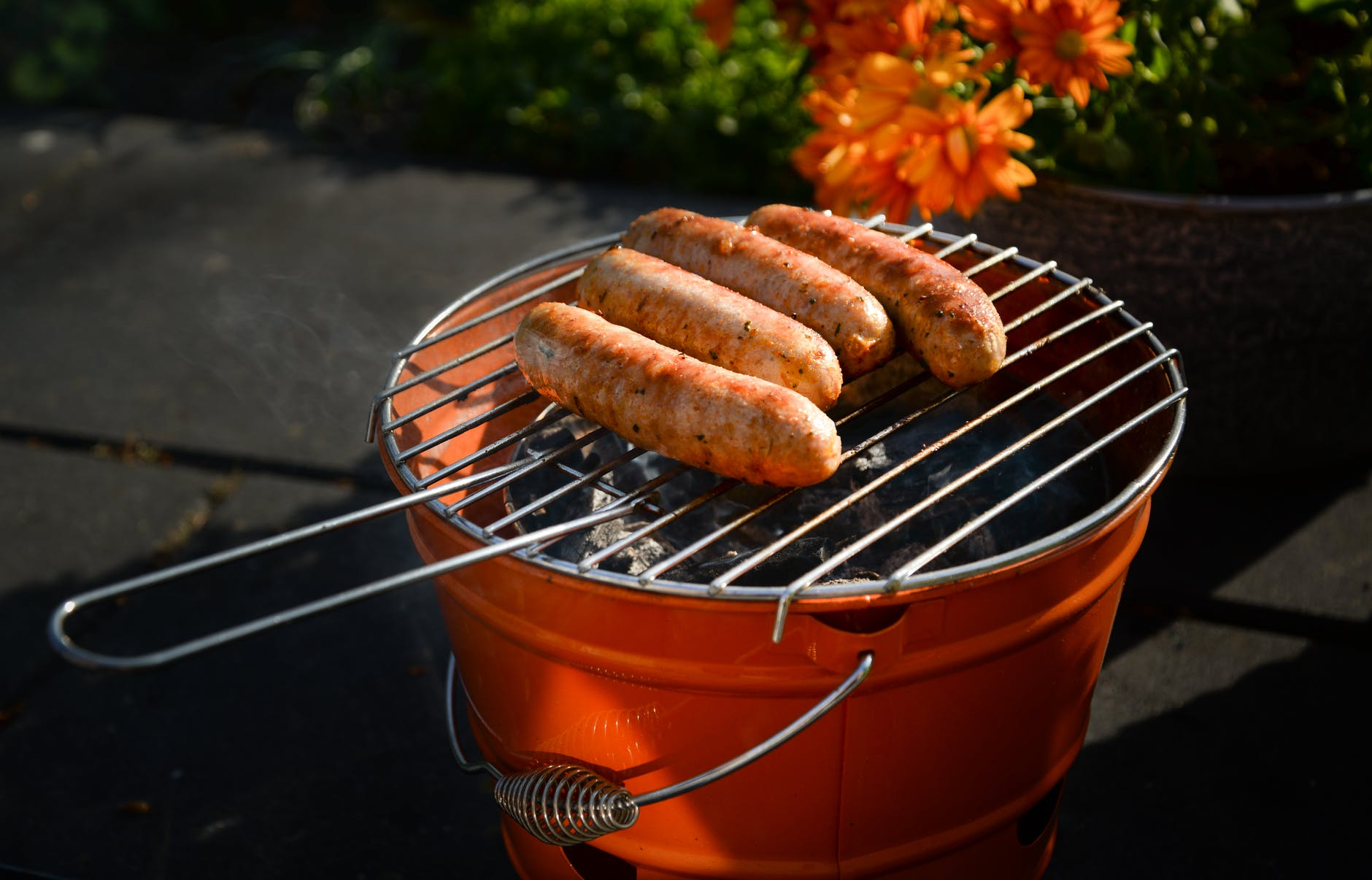 Photo of sausages on a grill