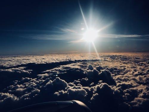 Gratis lagerfoto af fromtheplane, himmel, skyer, sol