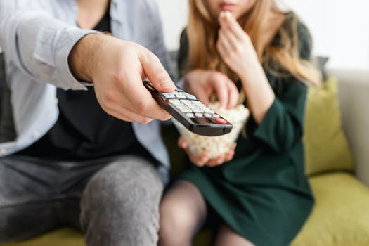 Man Holding Remote Control