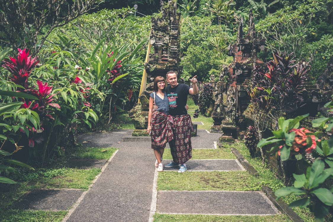 Woman and Man Standing Together and Looking on Flower Garden