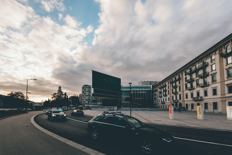 Black Car Near Concrete Building