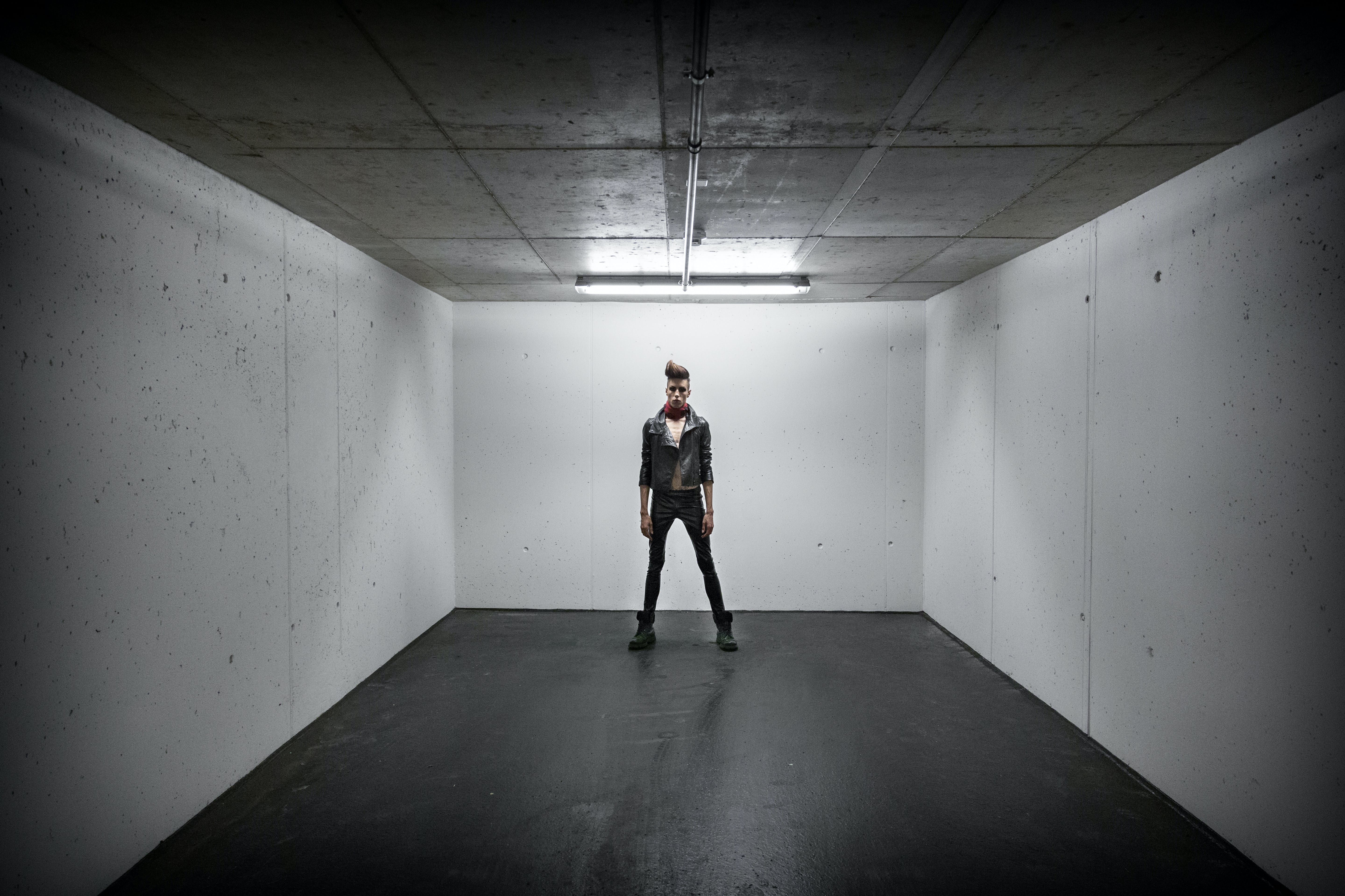 Person Standing Inside White Wall Box Room