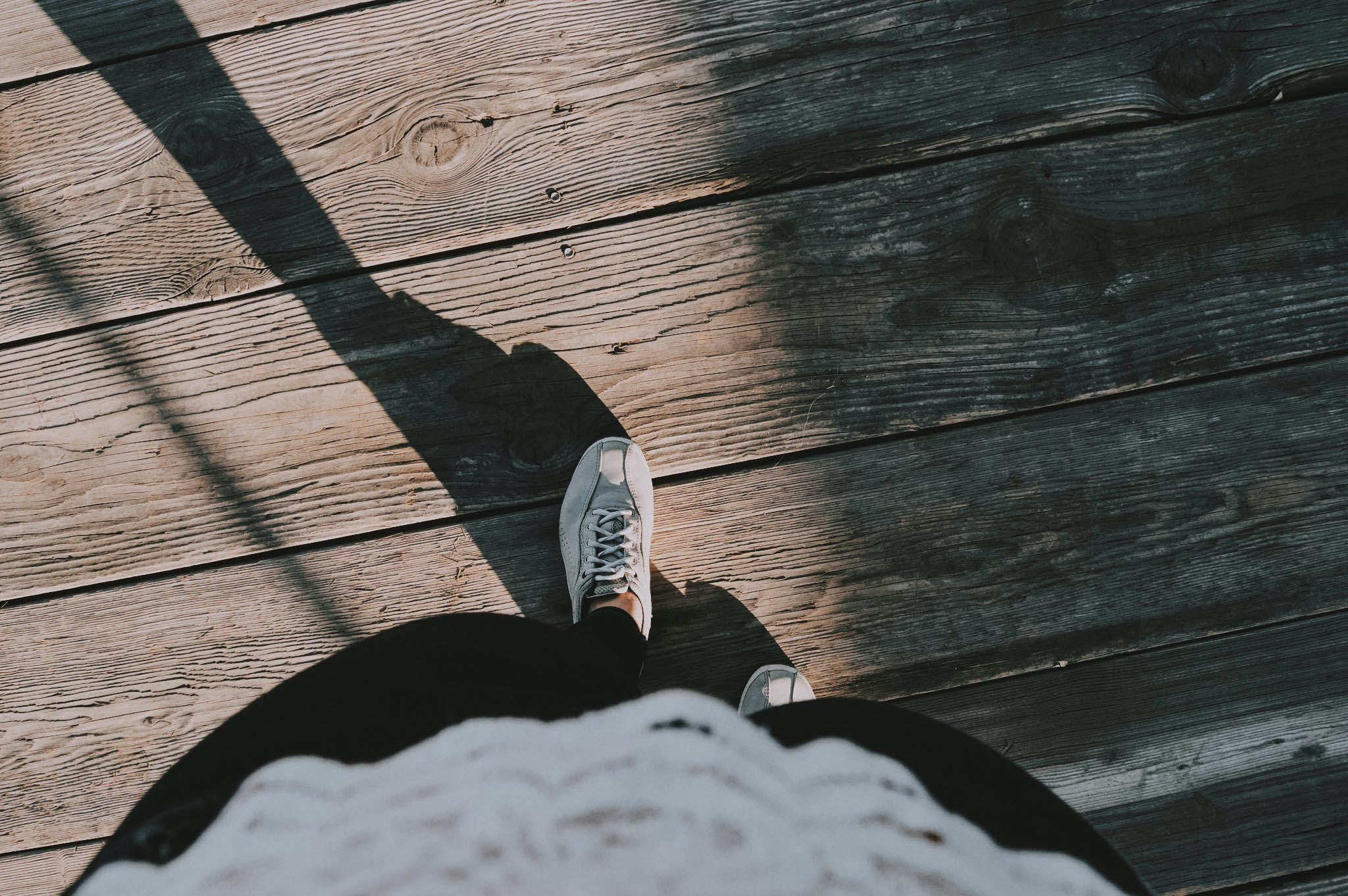 Person Wearing White Lace-up Shoes