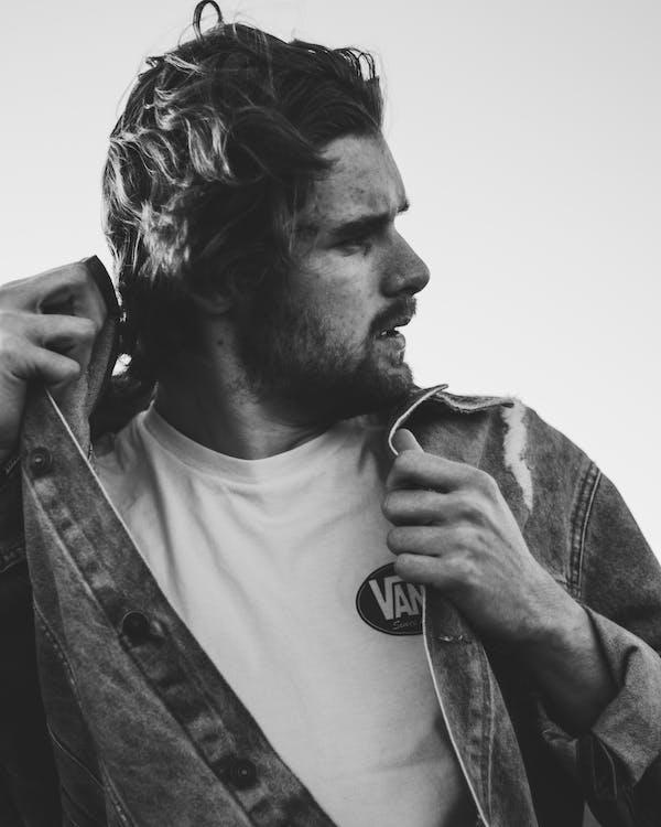 Greyscale Photography of Man Wearing Jacket