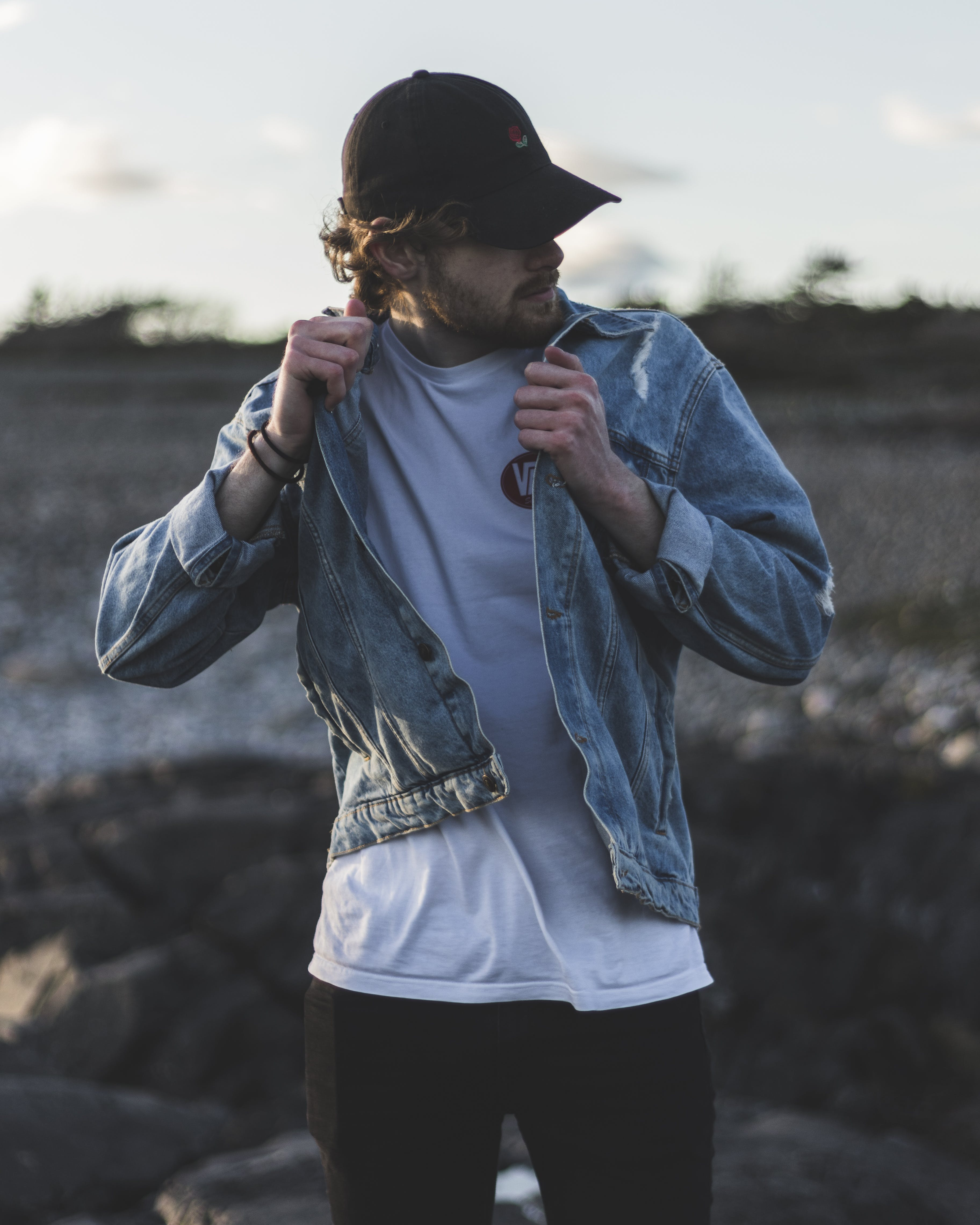 Man in Blue Denim Jacket, White Crew-neck Shirt and Black Pants