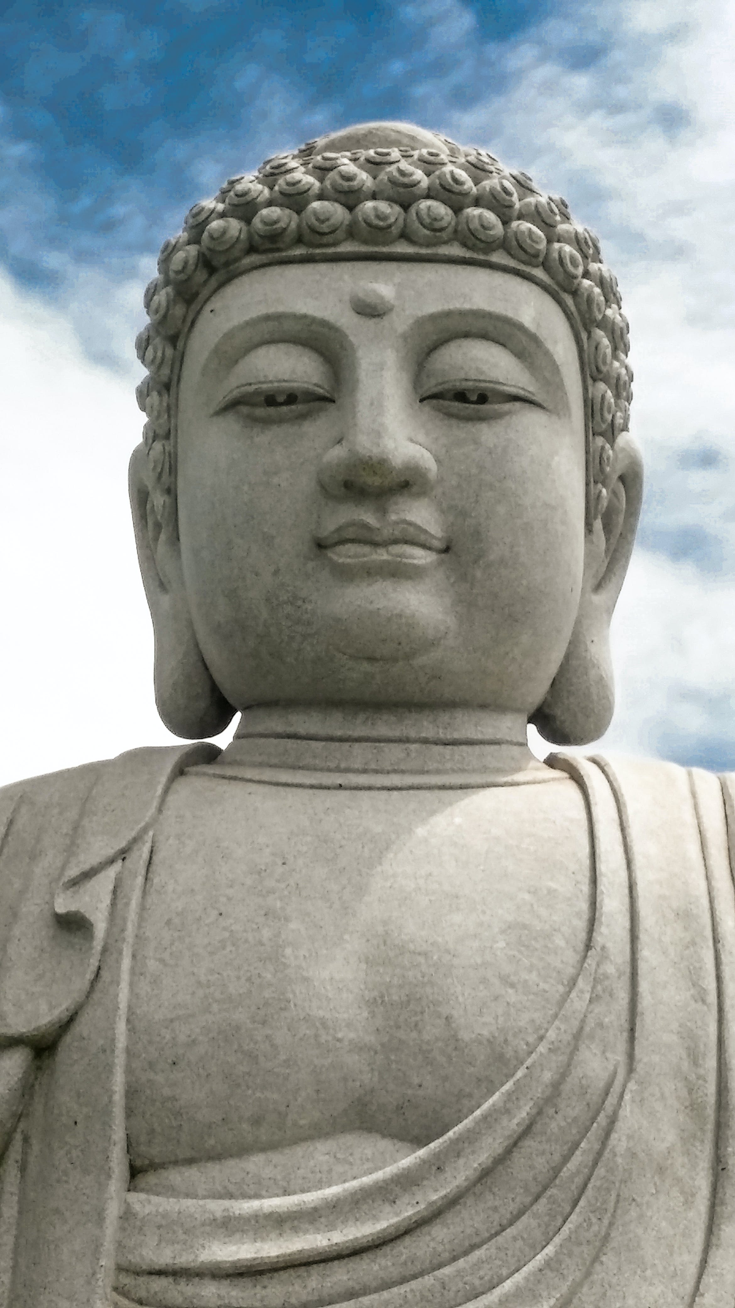 Buddha Statue Under White Clouds