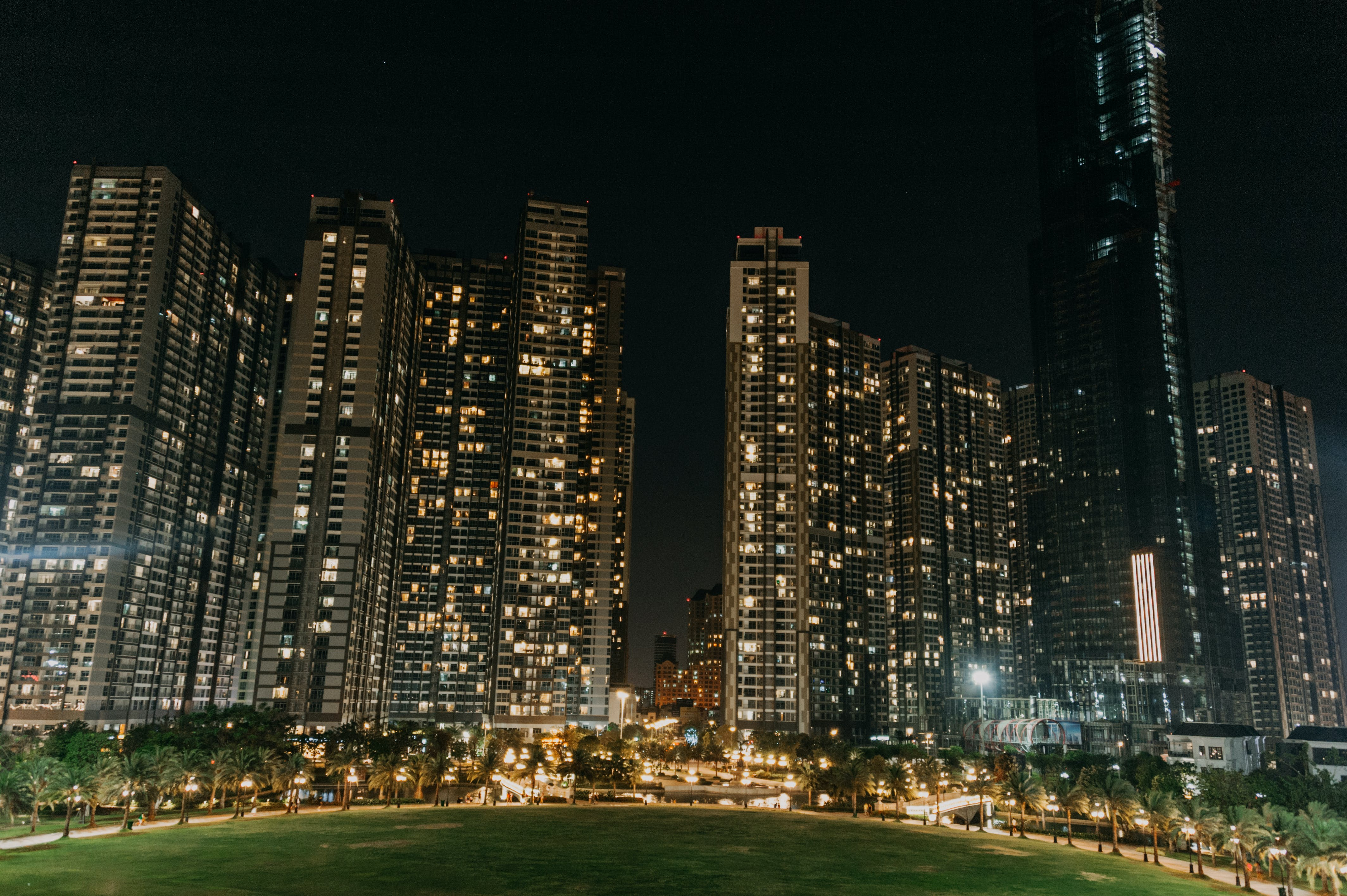Lightened High Rise Buildings at Night Time