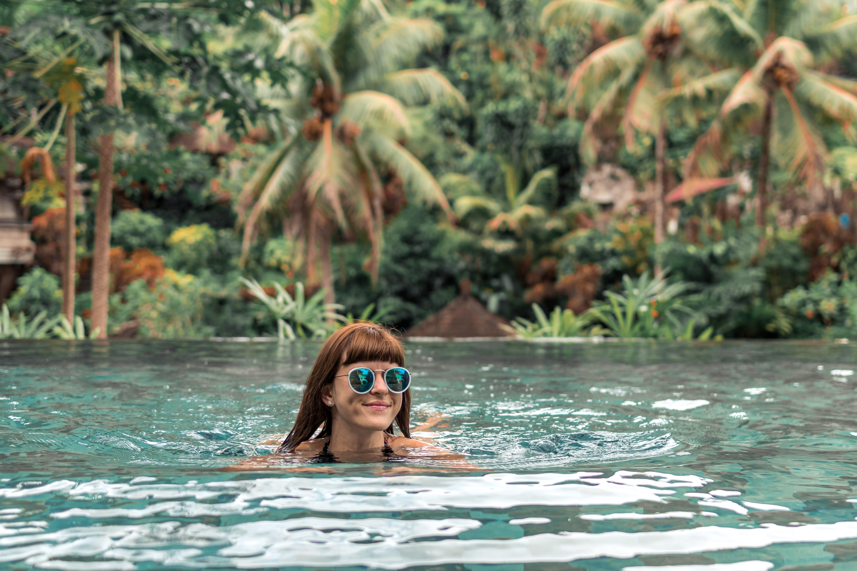 Woman Swimming Wearing Green Sunglasses