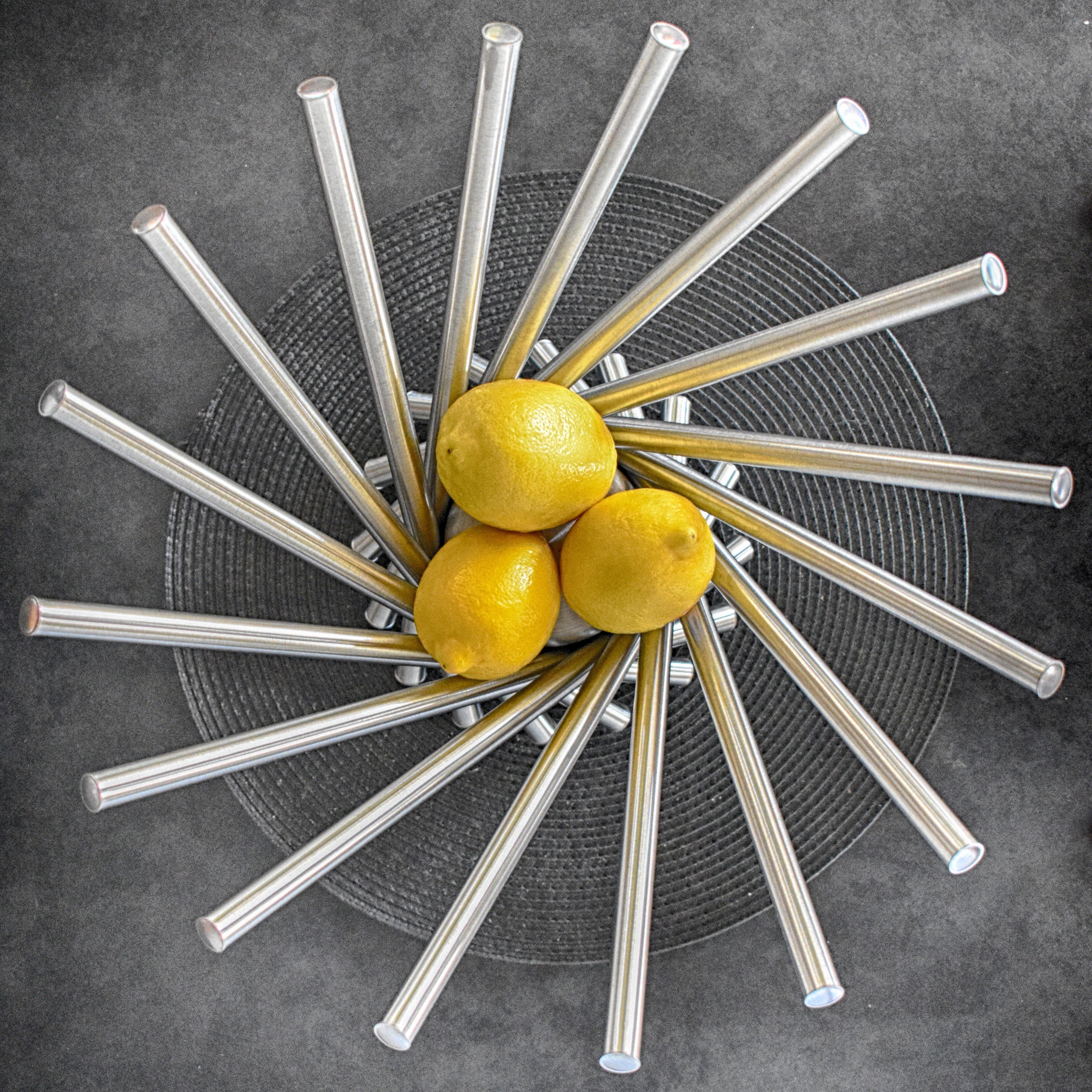 Three Lemon Fruits on Steel Bowl