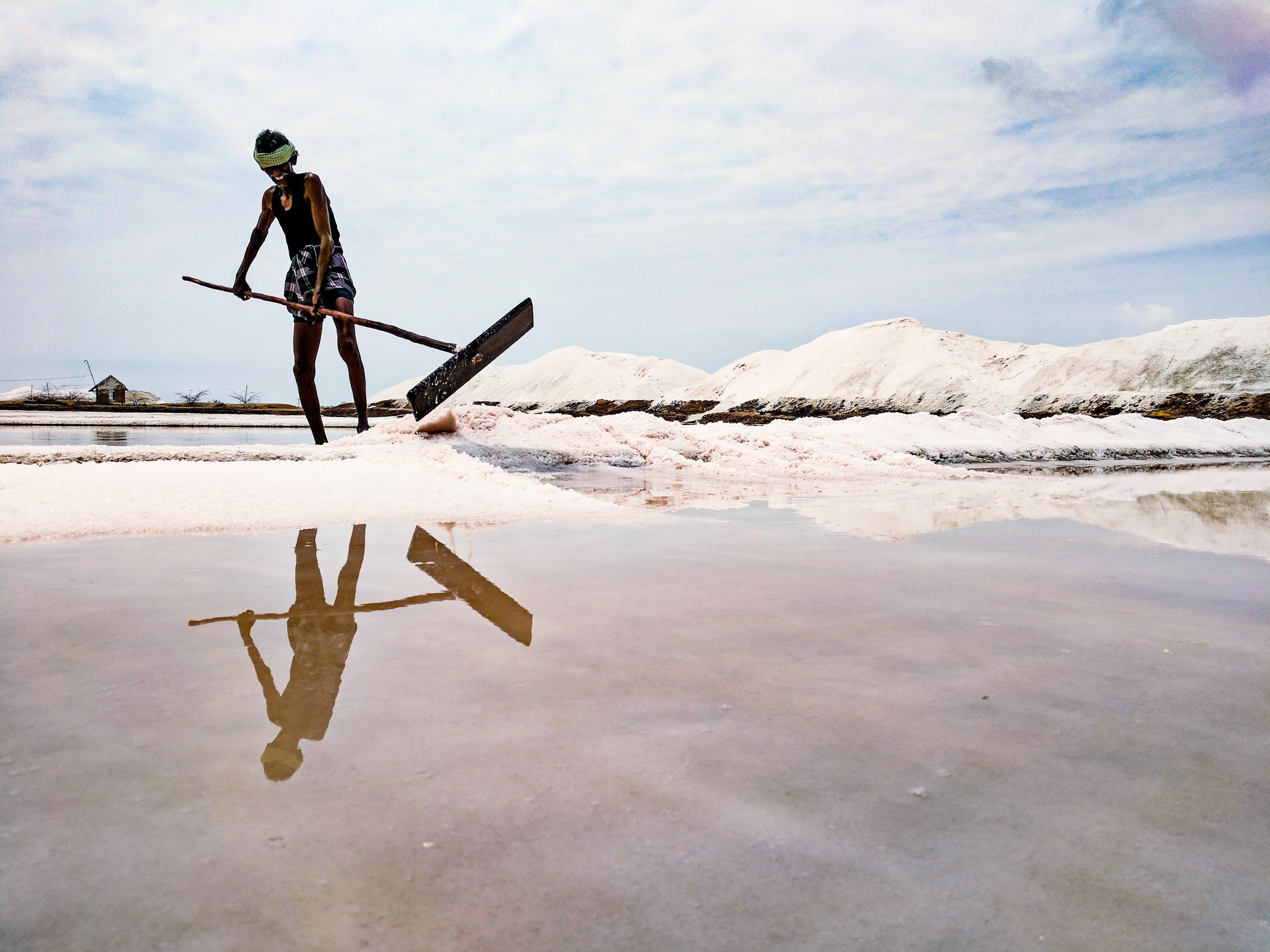 Man Plowing Salt
